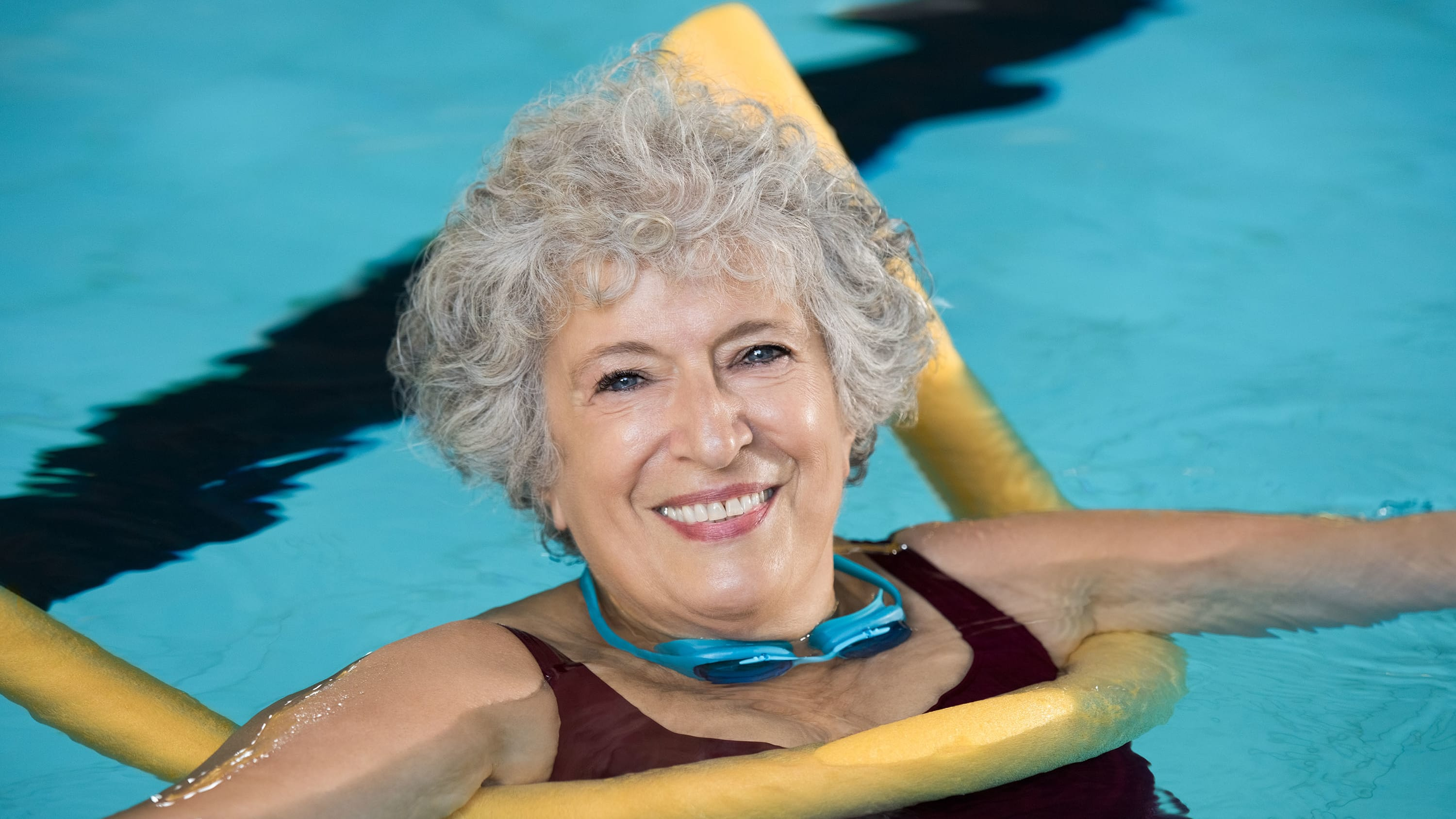 woman enjoying water aerobics, possibly after undergoing bariatric surgery