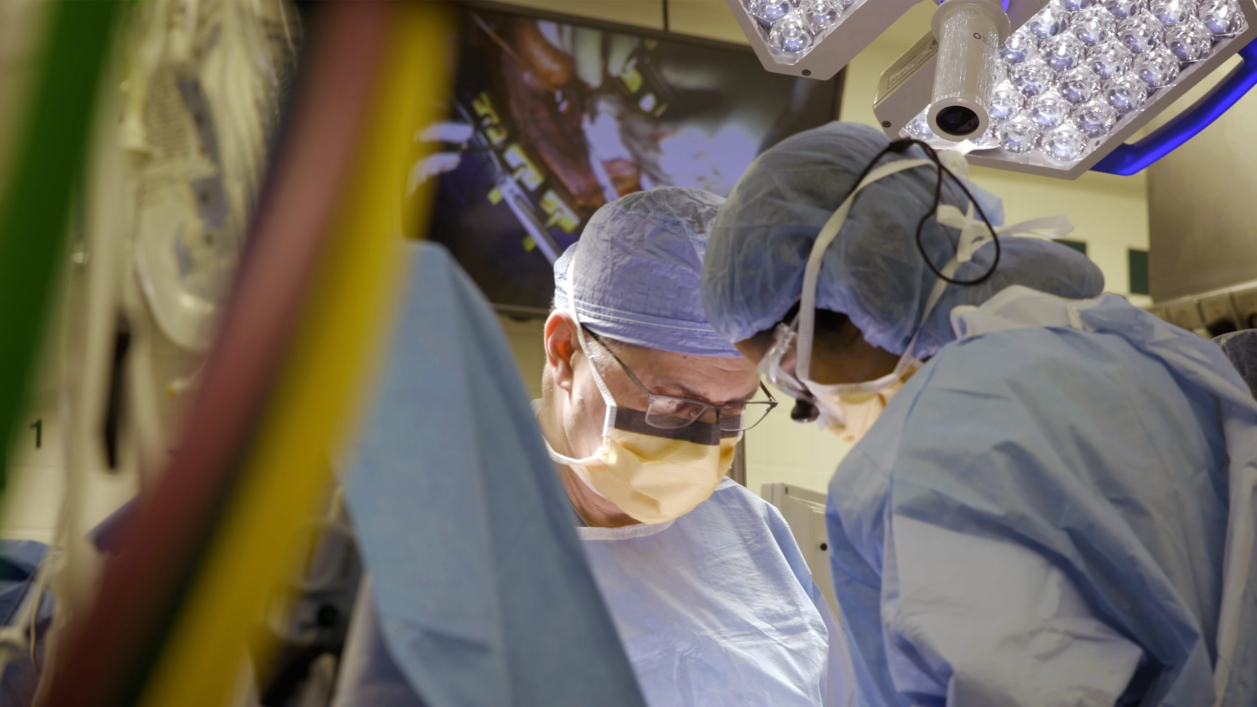 Doctors perform open heart surgery, possibly repair a ruptured aortic aneurysm