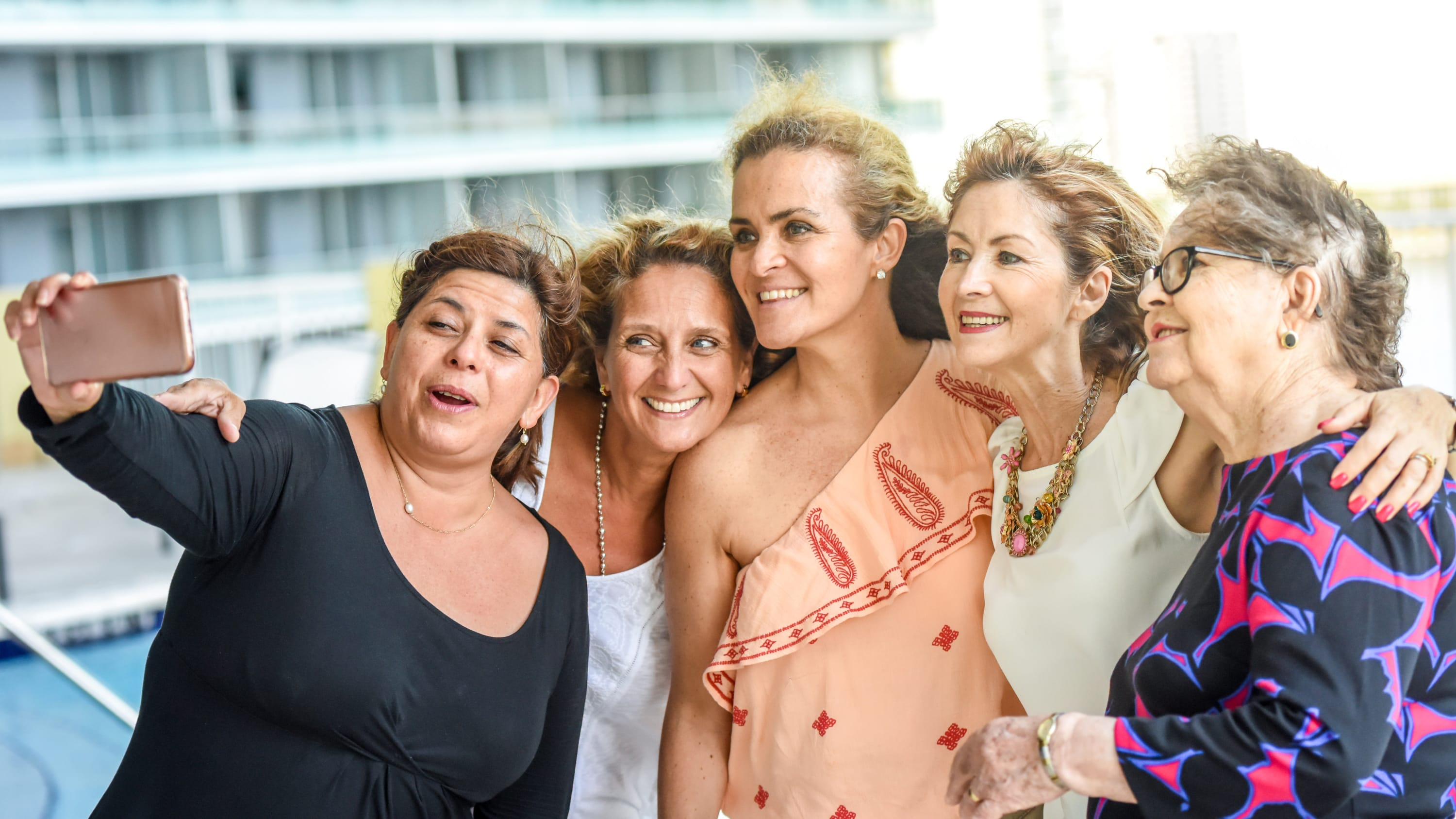 A group of women who could be cancer survivors take a selfie together.