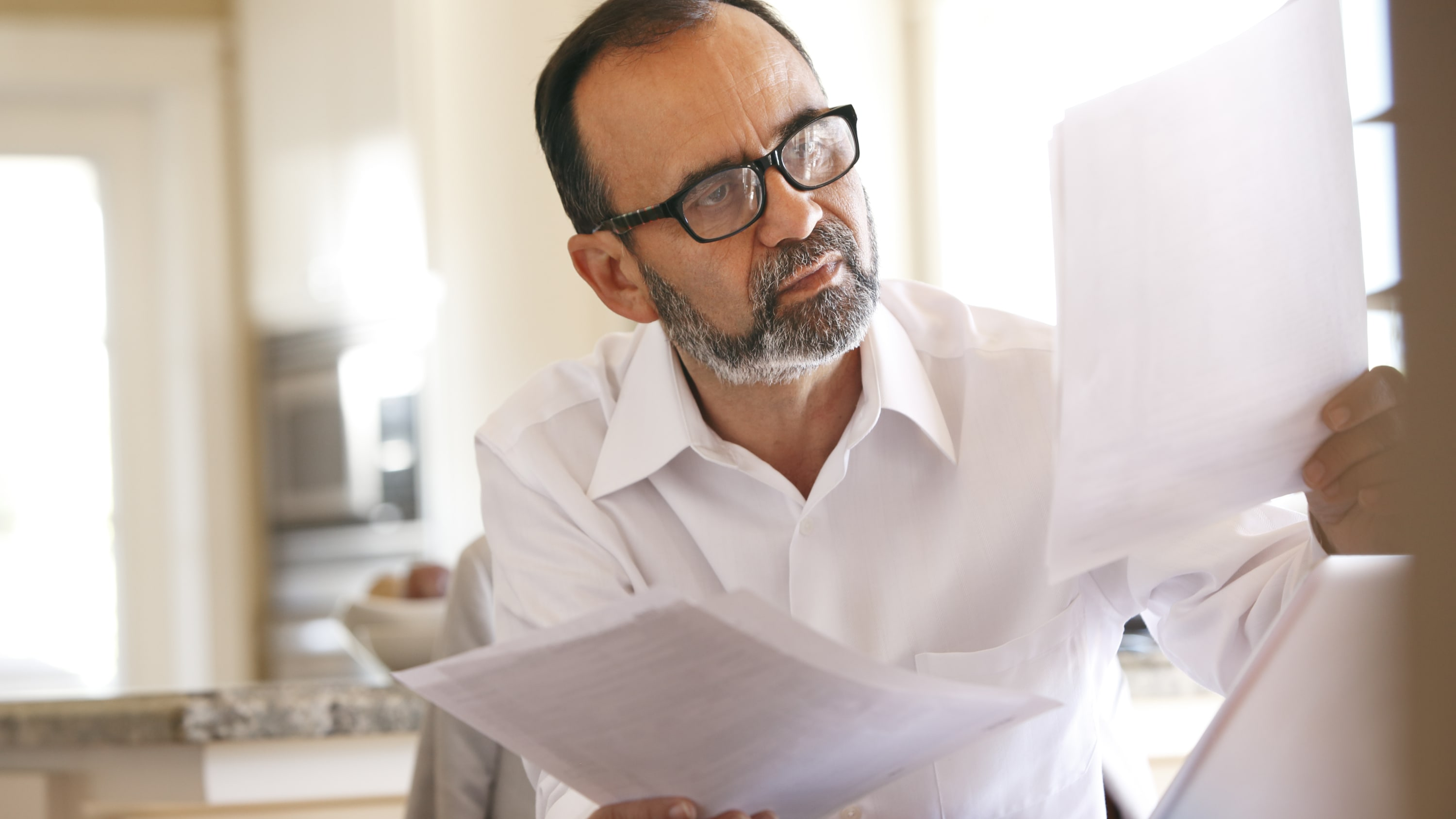 Man working at  his desk in an office may have aortic valve disease
