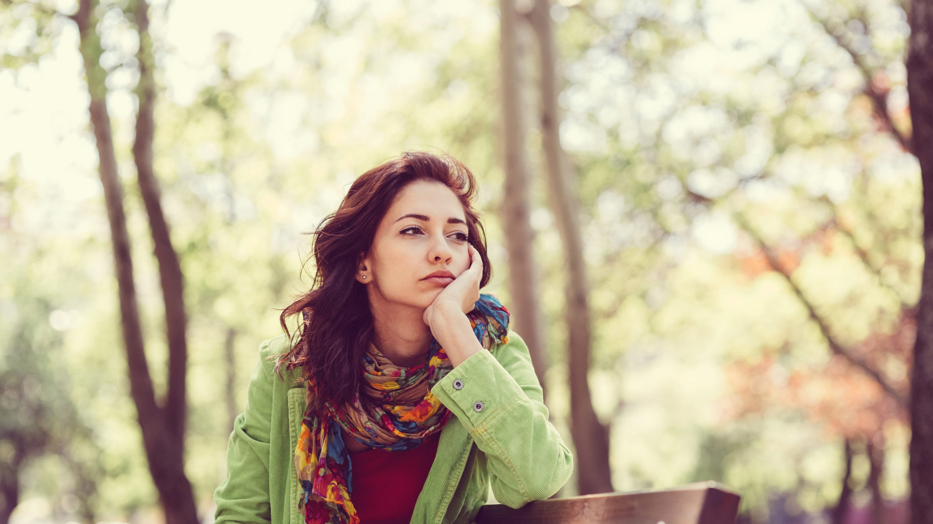 Thoughtful woman, possibly worried about HPV-related cancer