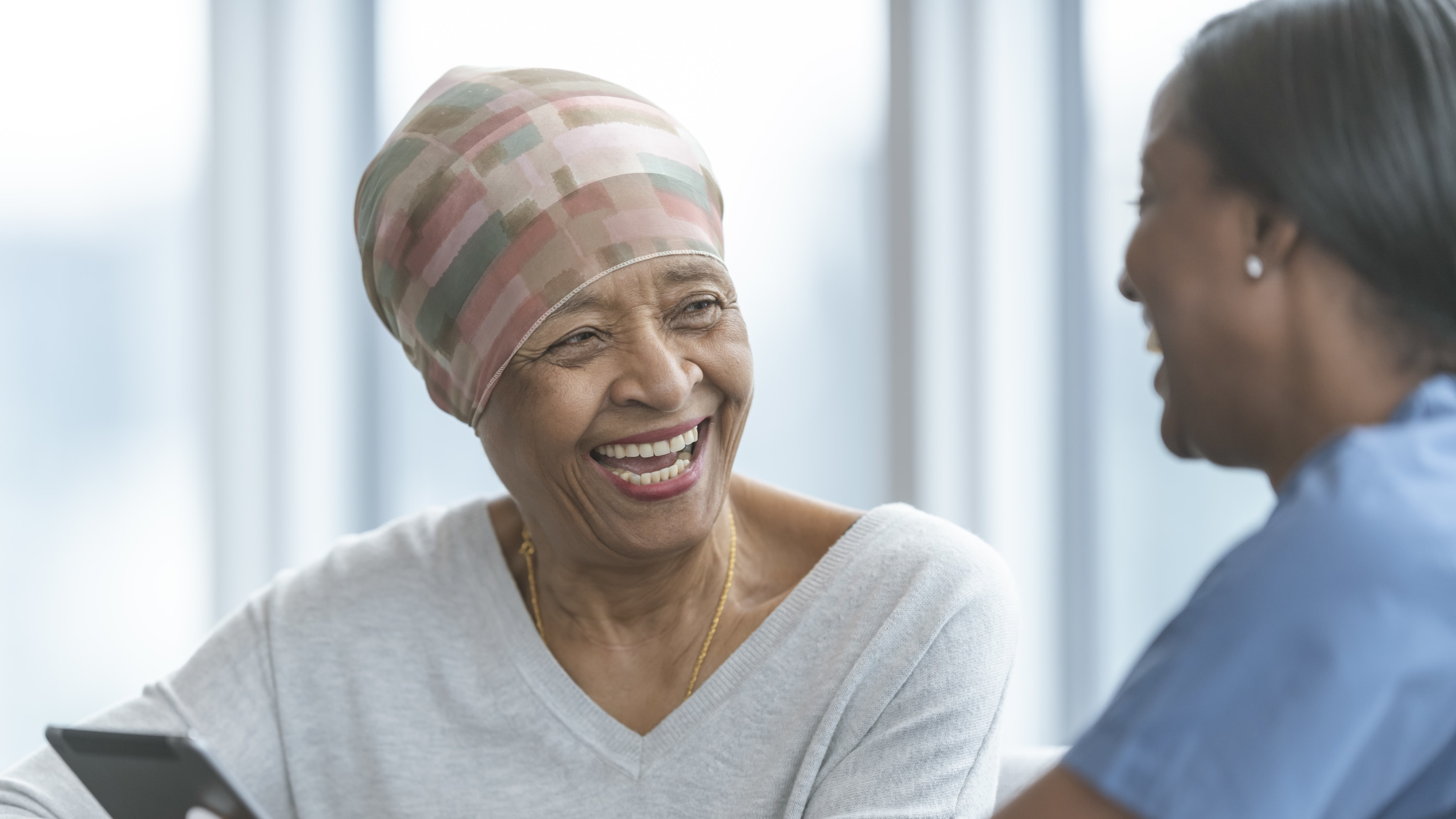 Senior woman happy possibly after lymphedema treatment
