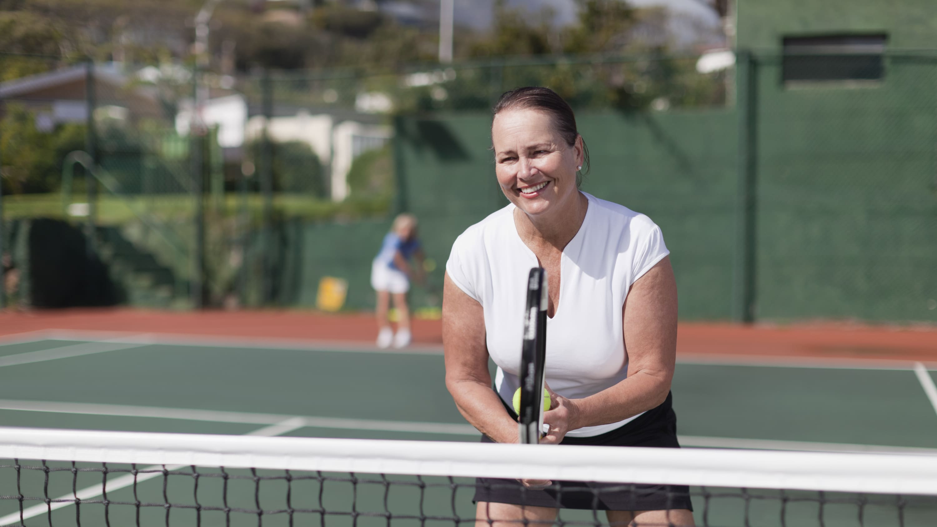 A woman back to enjoying her favorite activity of tennis after being treated for structural heart disease.