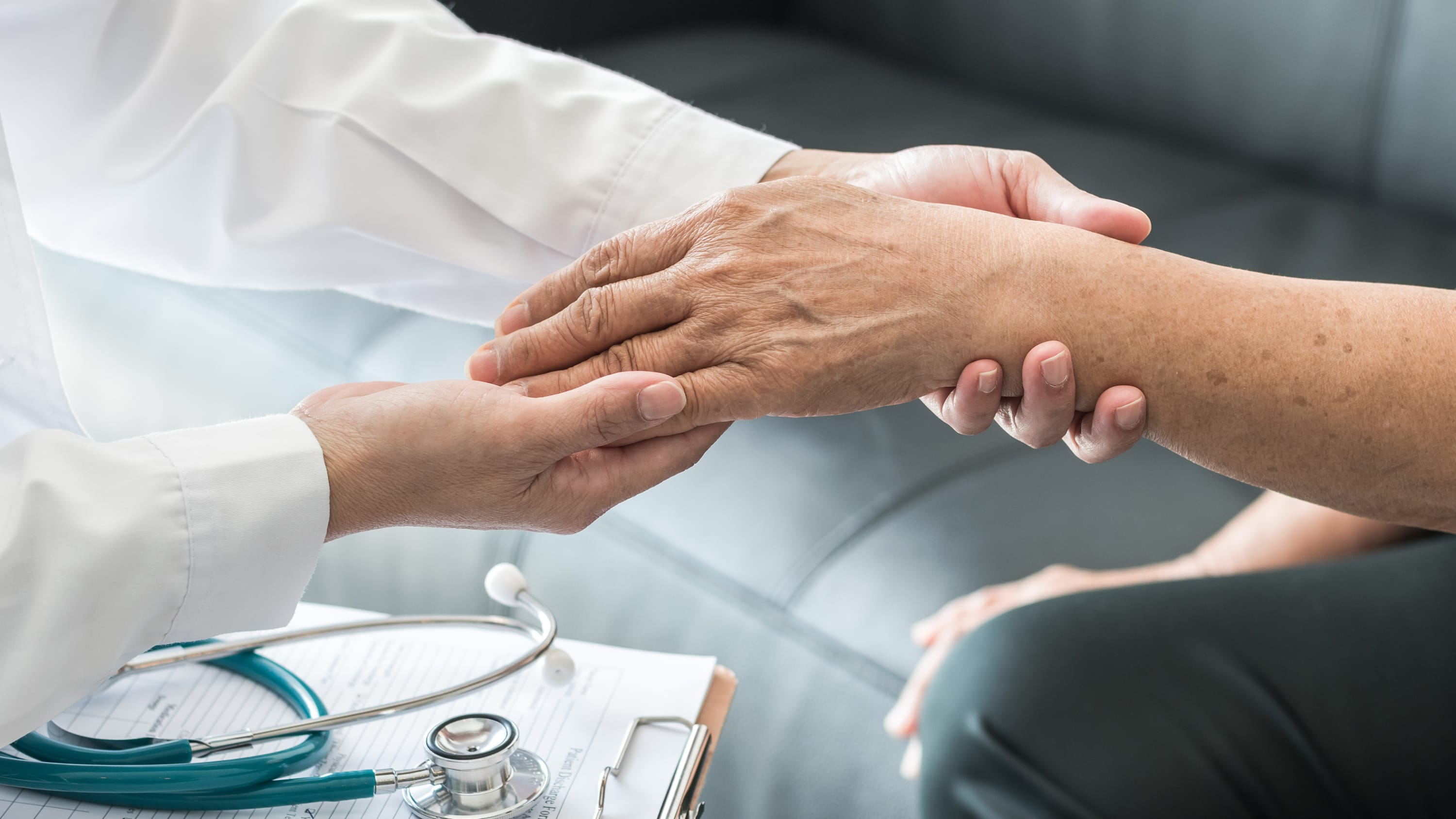 Doctor checking an arm, possibly for vascular malformations
