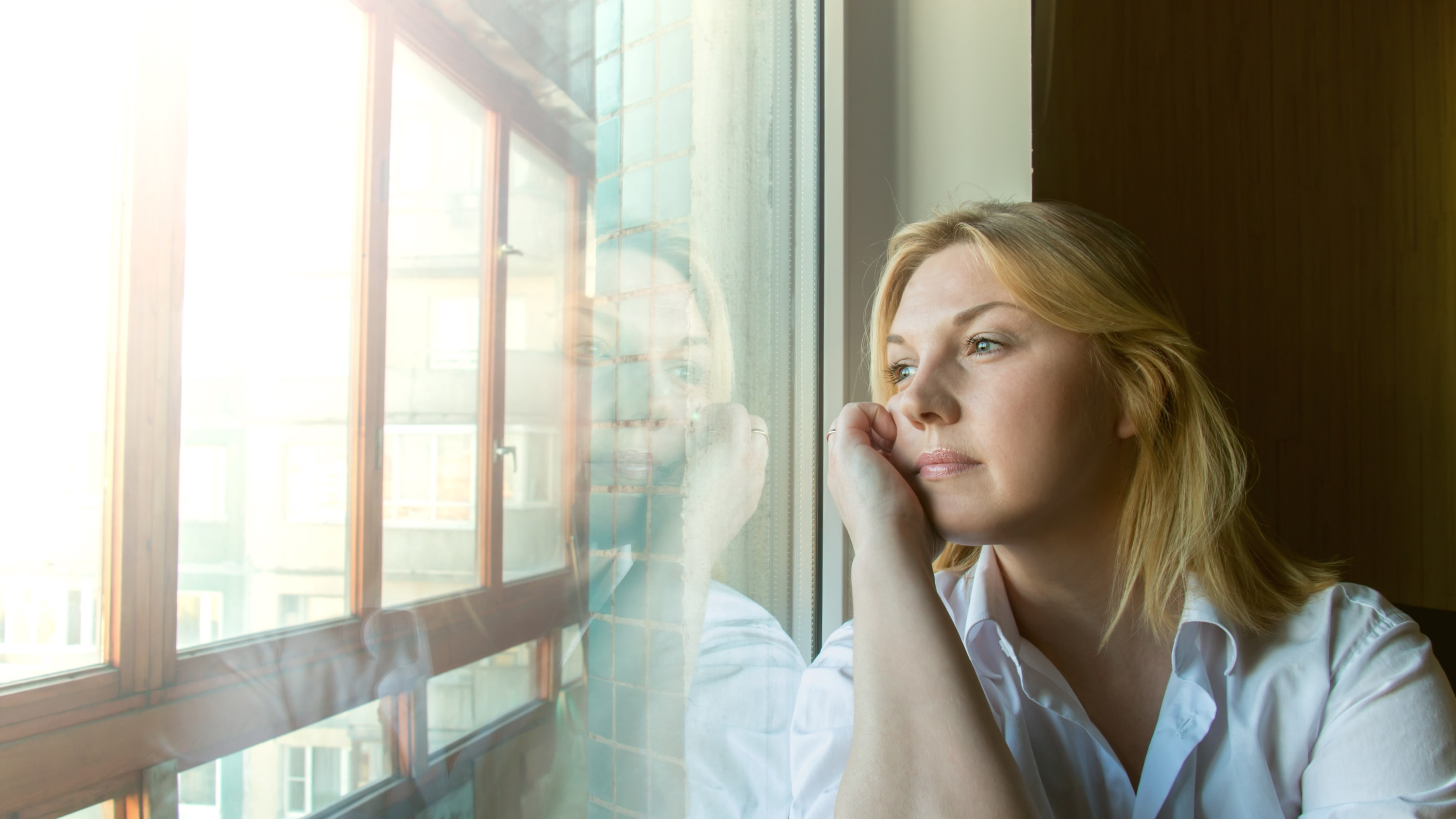 A woman possibly thinking about a colorectal cancer diagnosis