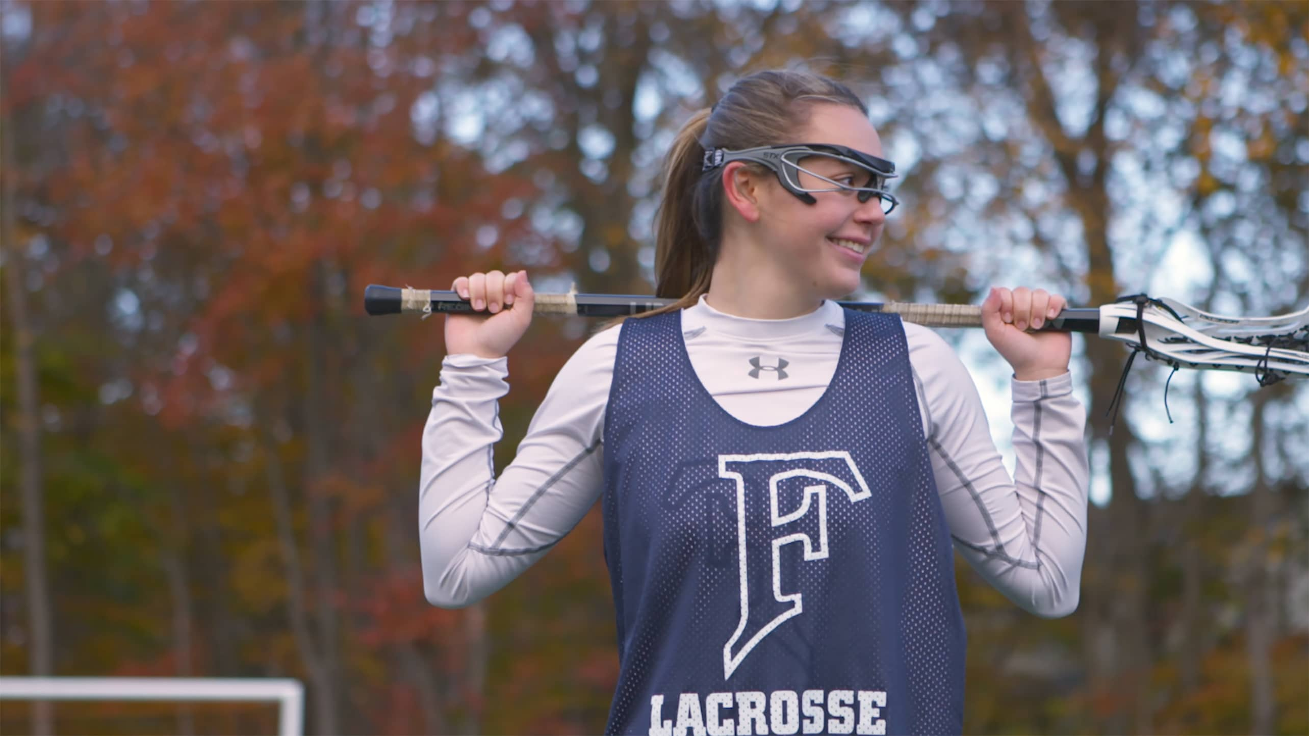 A lacrosse player holding her lacrosse stick.