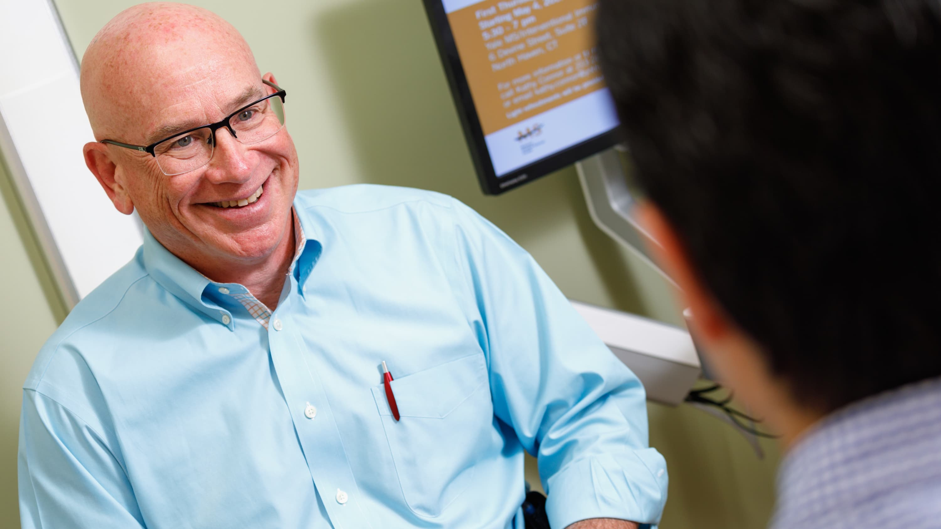 Dr. Honig talks to a patient.