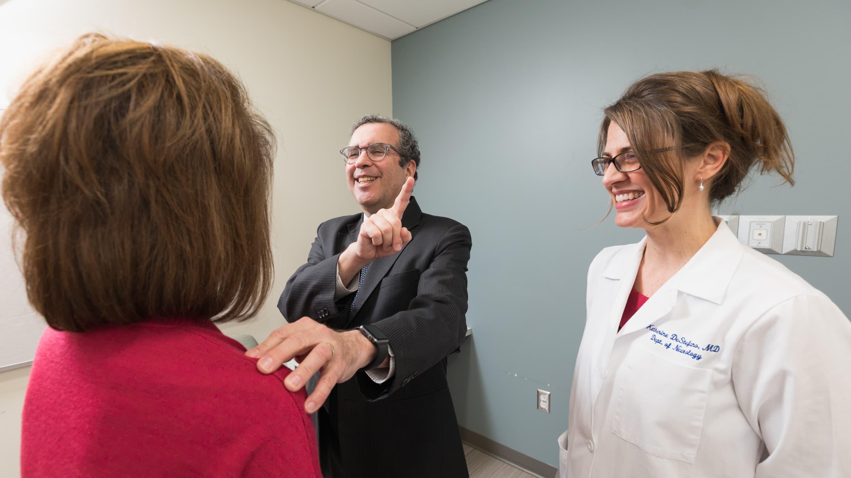 Dr. Hafler with a patient.