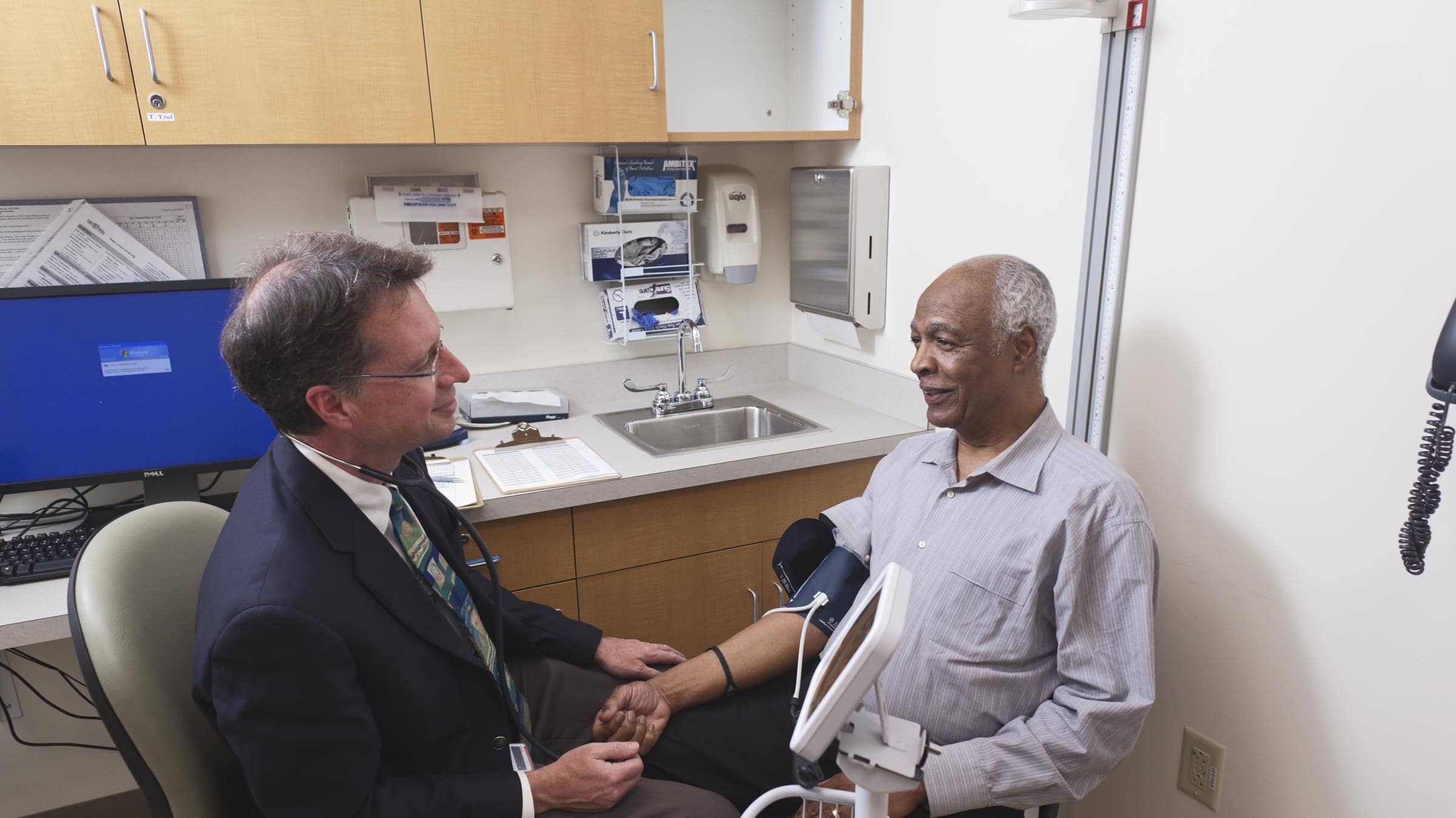 Dr. Gill taking a patient's blood pressure