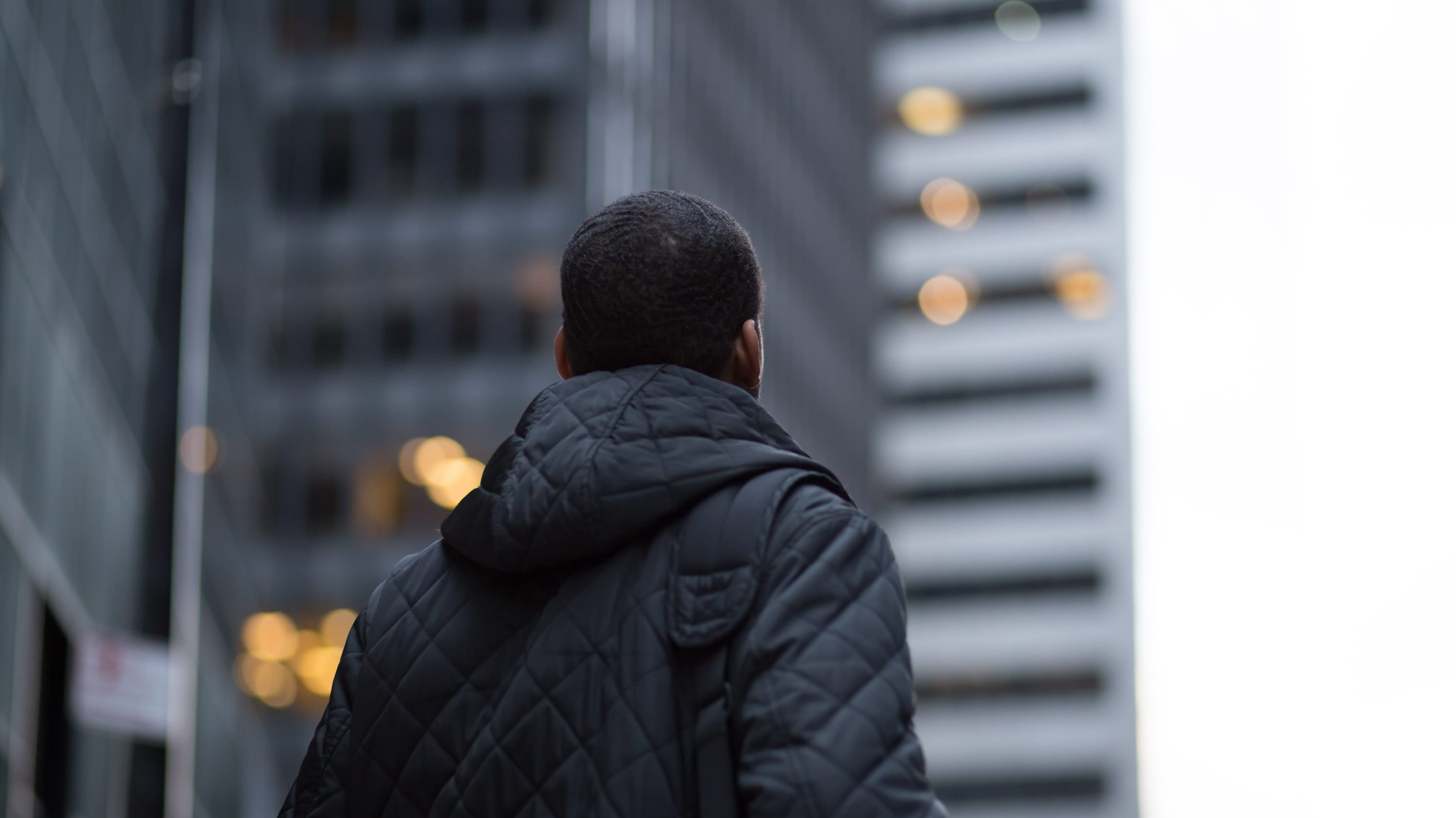 A man outside with his back turned may have an anxiety disorder.