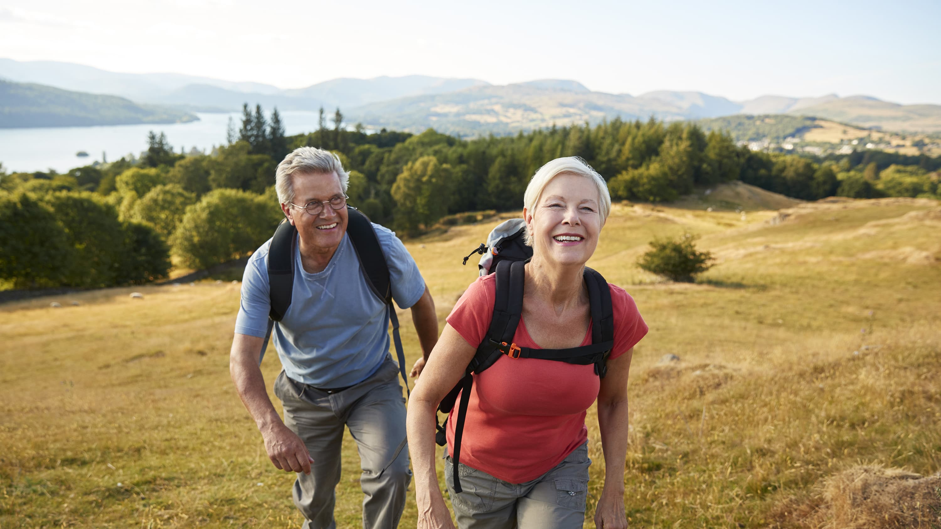 An older couple hiking after undergoing bicuspid aortic valve repair.