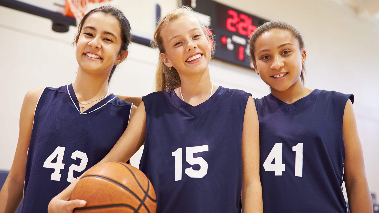 girls holding a basketball