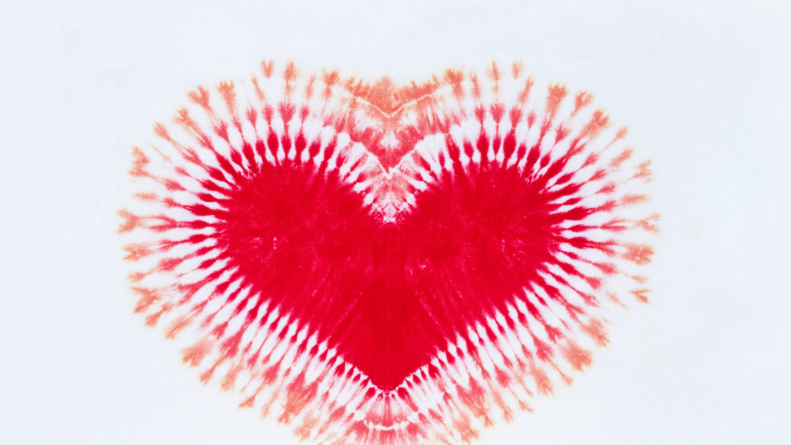photograph of a tie-dyed heart, representing efforts to eliminate the stigma associated with menstruation