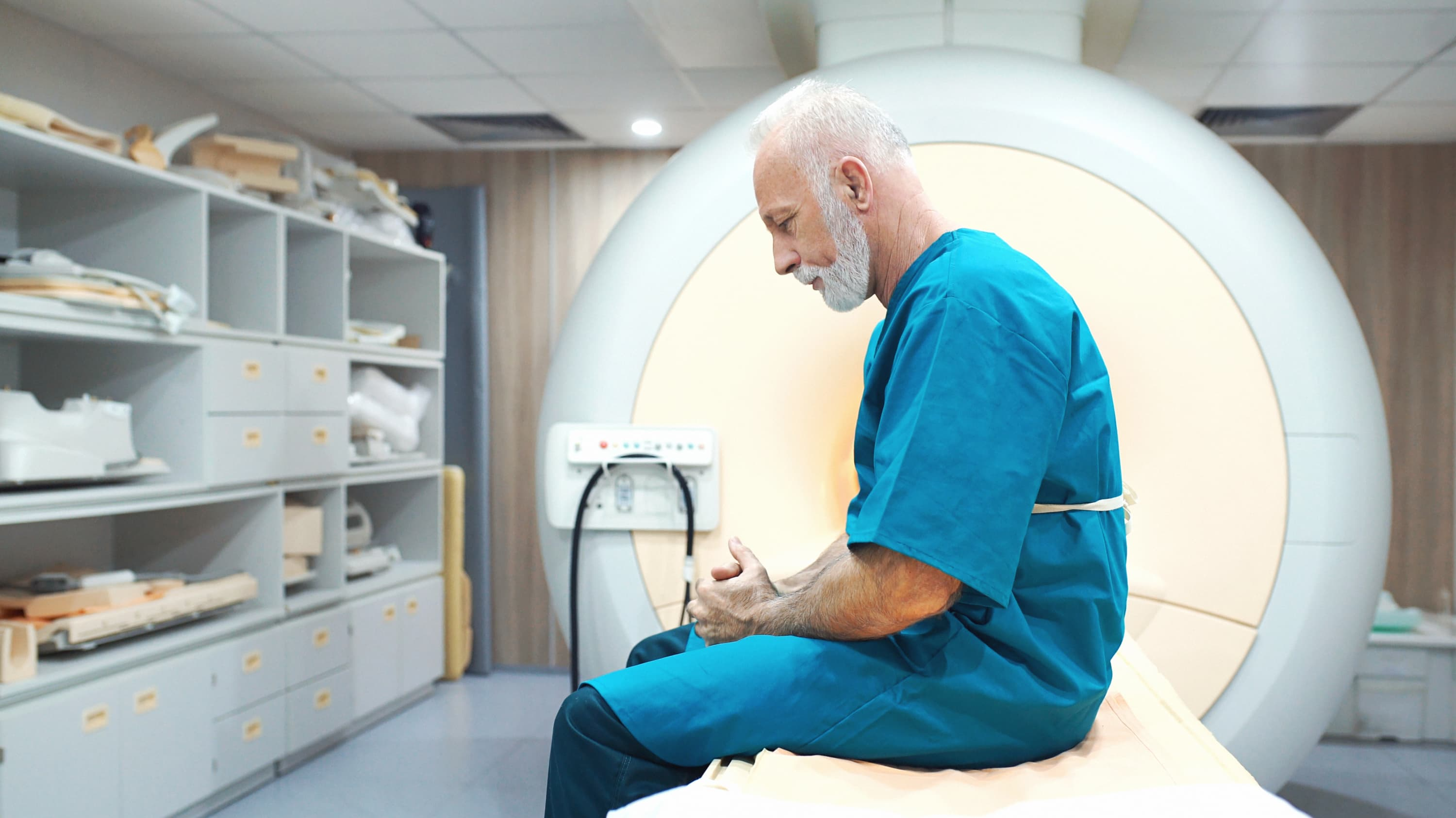 senior man at an MRI scanning clinic waiting to be examined, possibly to see the results of Car T-cell Therapy