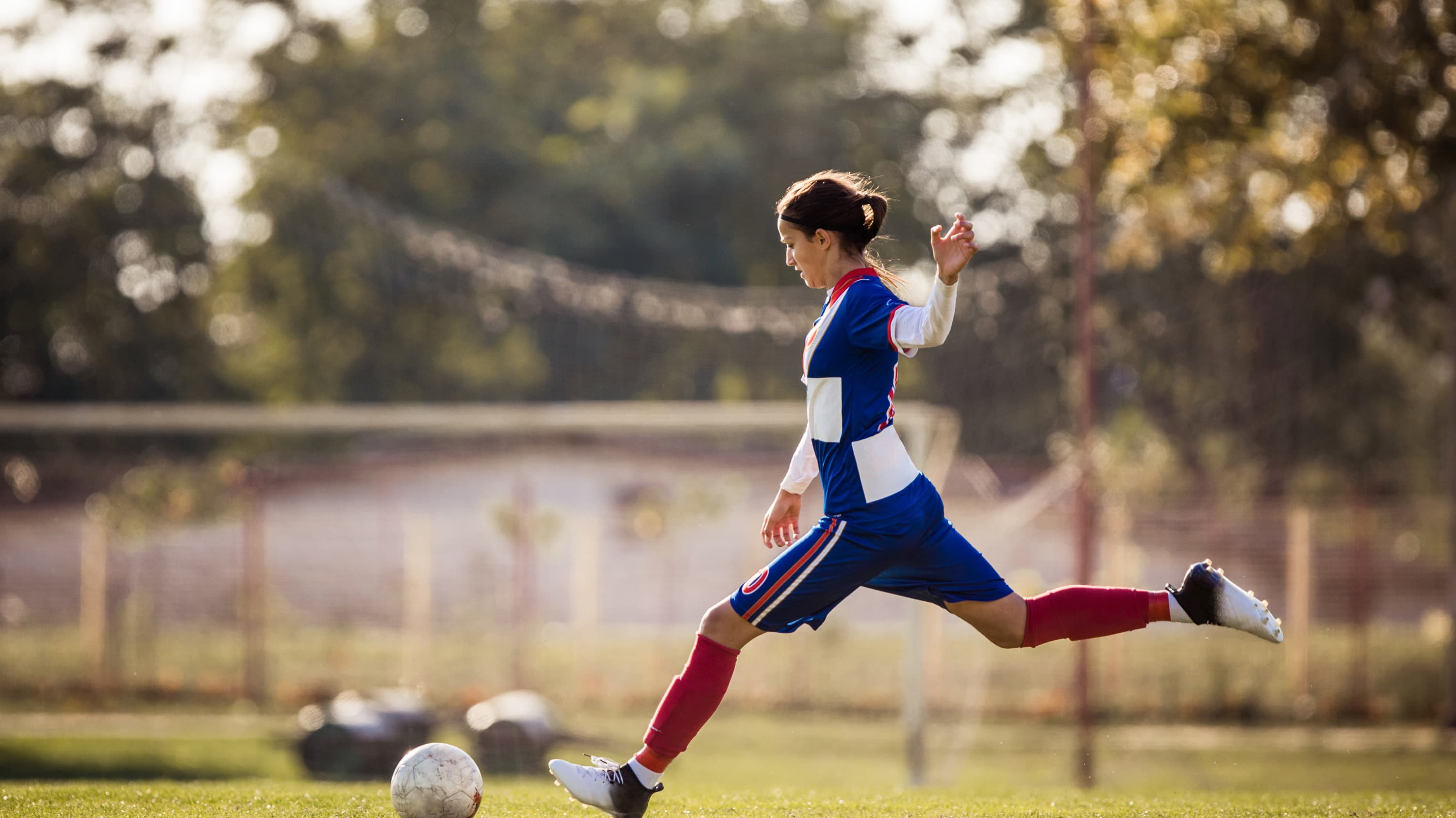 Female soccer player, who may be more at risk for ACL injury than her male peers