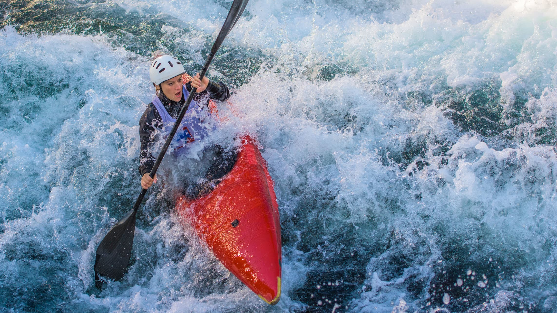 A kayaker braves white waves, hopefully avoiding an outdoor emergency or injury