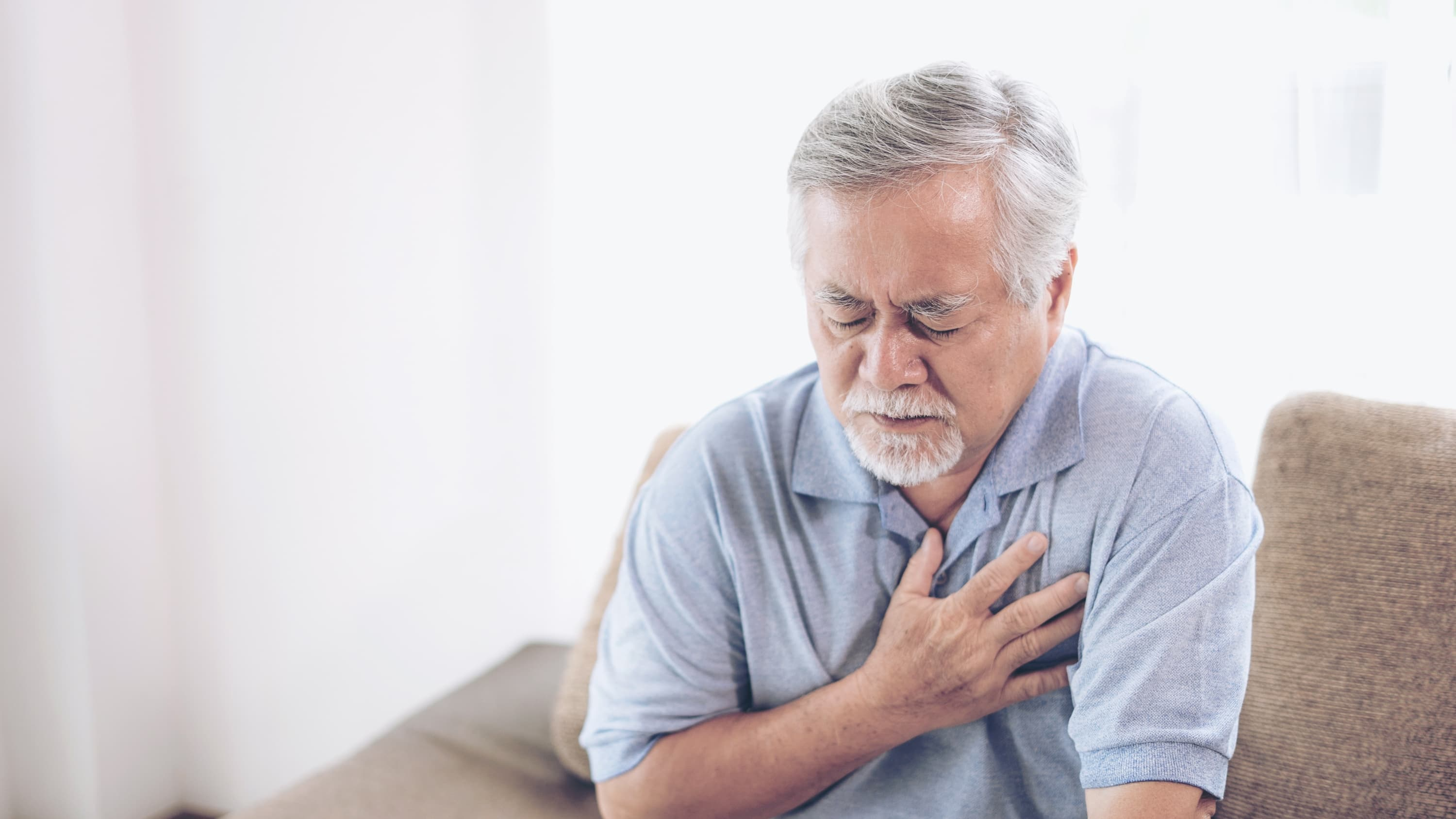 man with chest pain, possibly suffering from cardiac arrest