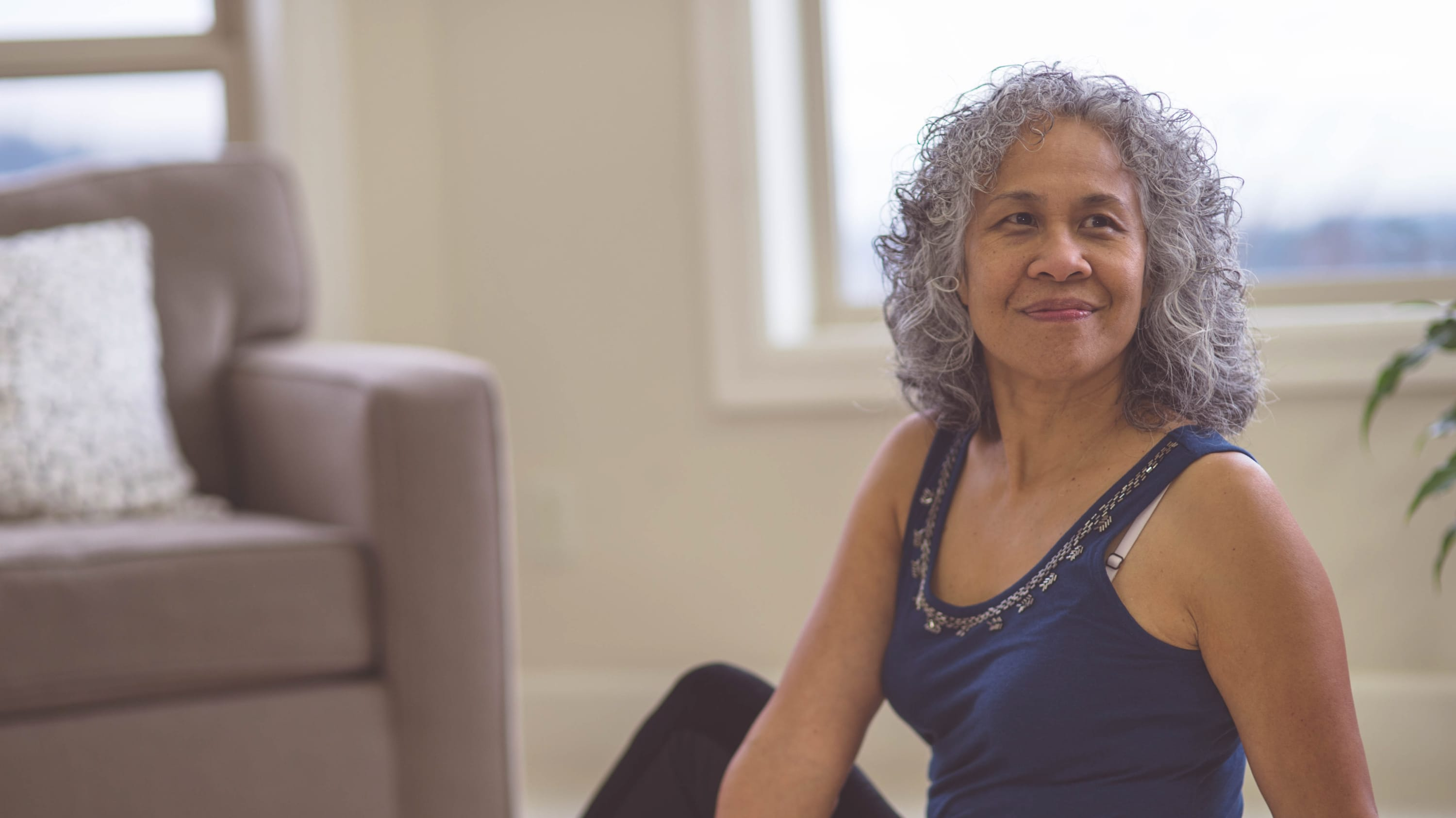 A middle-aged woman who is exercising and could be an ovarian cancer survivor.