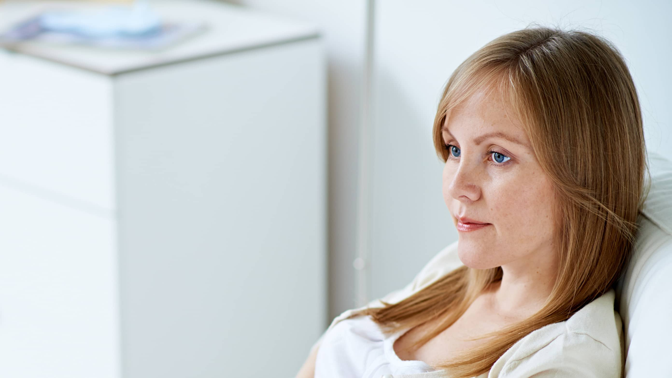 a woman looks concerned, possibly because of recurrent pregnancy loss.