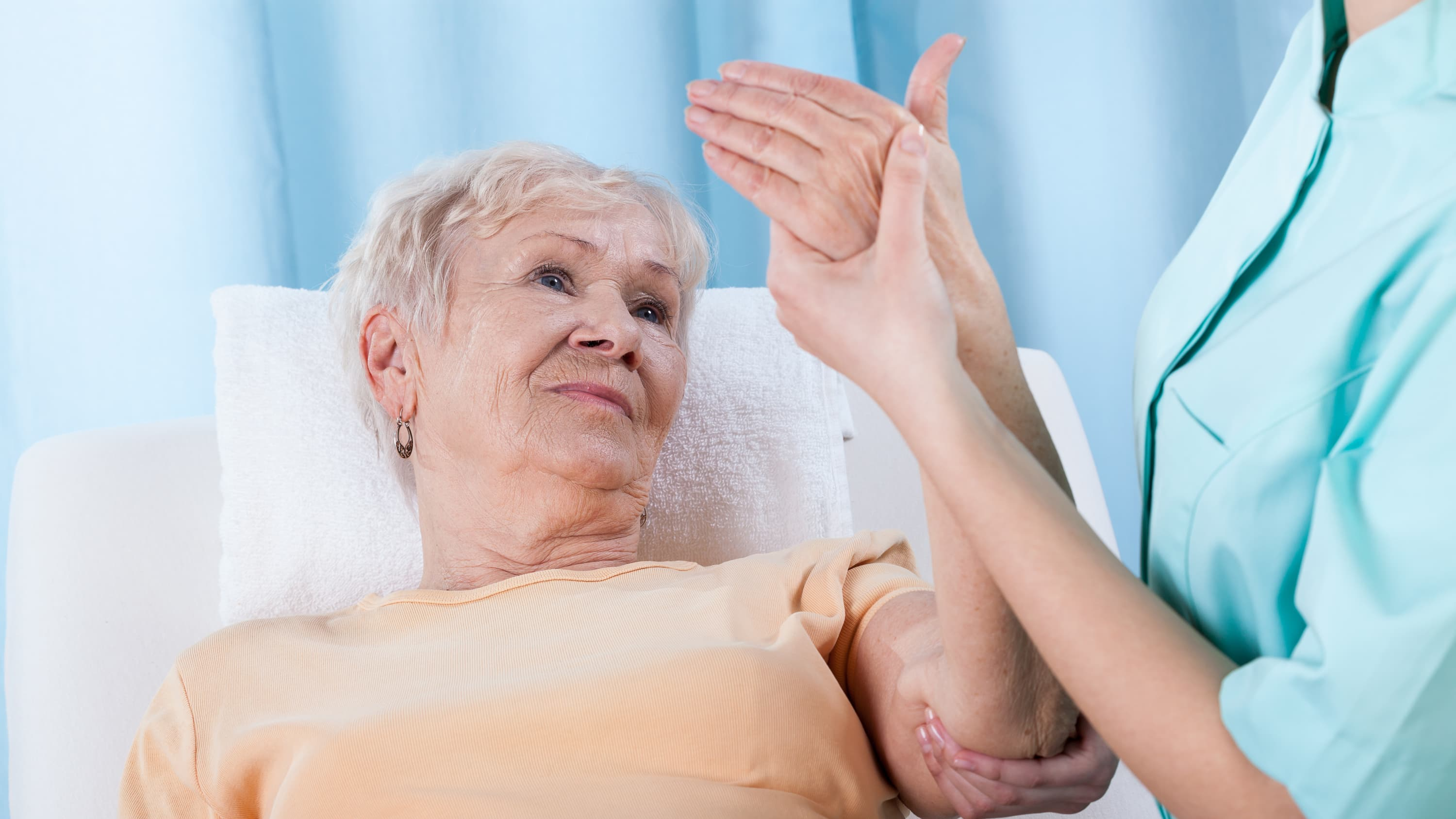 An older woman is checked for osteoporosis.