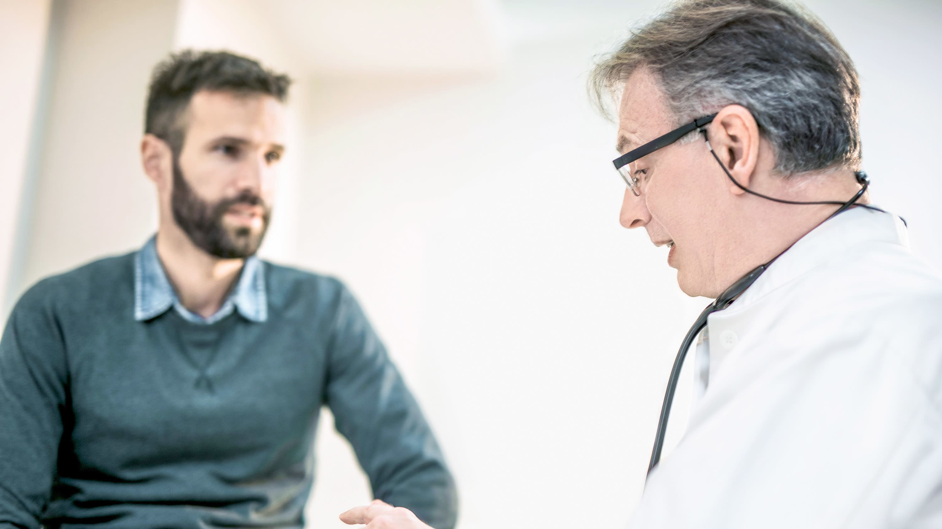 Doctor and patient, perhaps discussing minimally invasive surgery