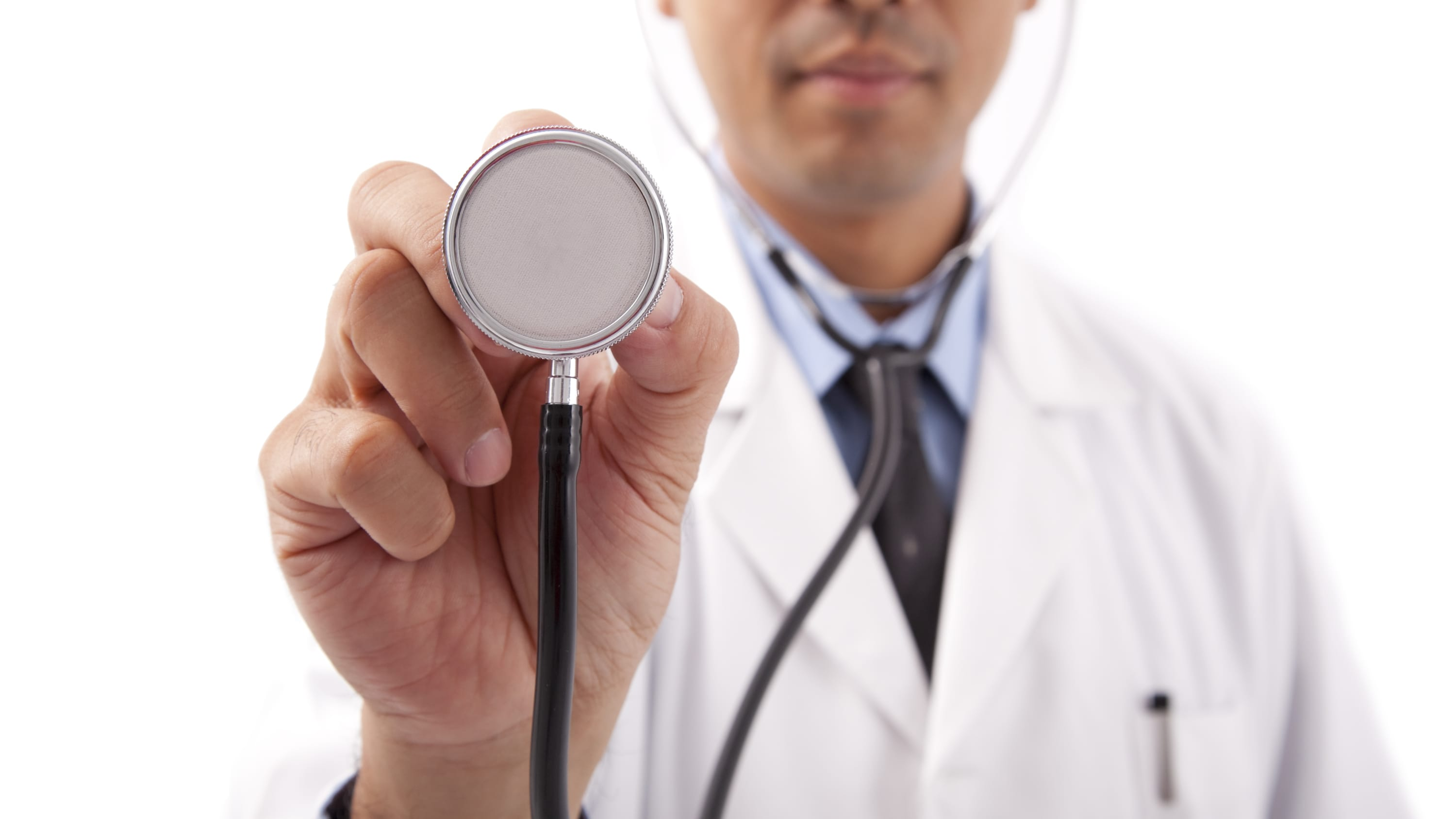 A doctor holds up a stethoscope used to examine a patient who may have a cardiomyopathy.
