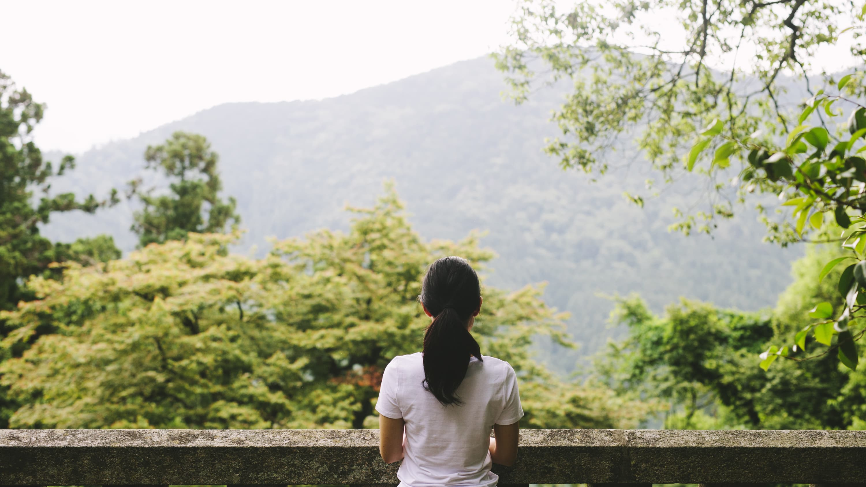 woman contemplating direction in life, especially during a quarter-life crisis
