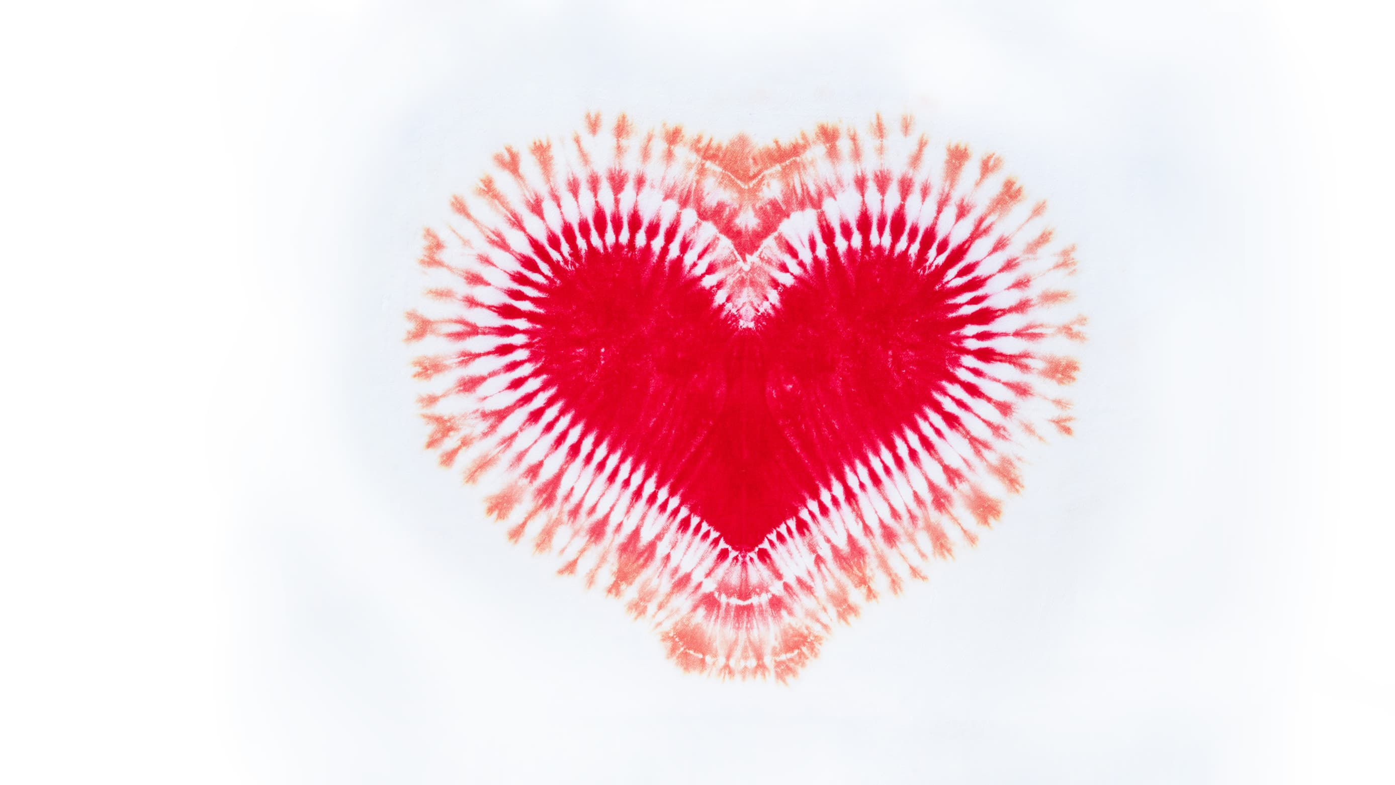 photograph of a tie-dye heart, representing efforts to eliminate the stigma associated with menstruation