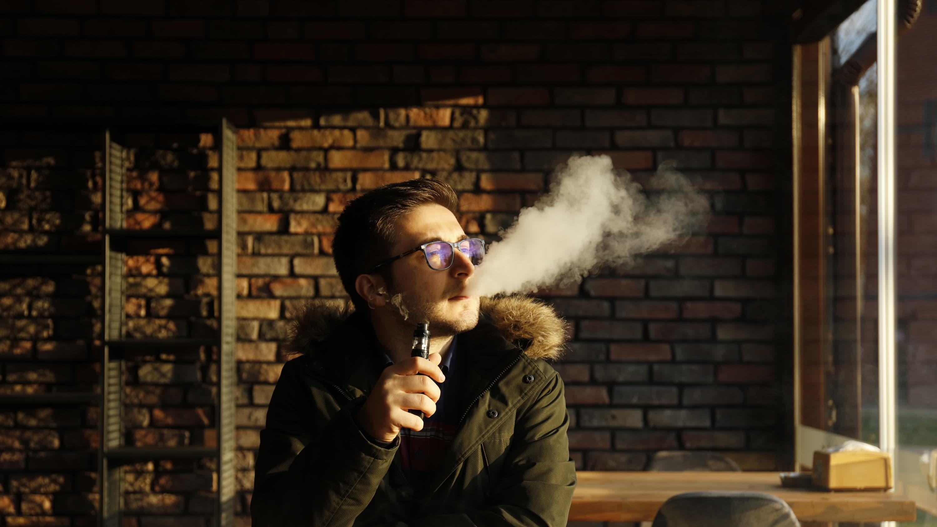 teen vaping, possibly unaware of the addictiveness of nicotine