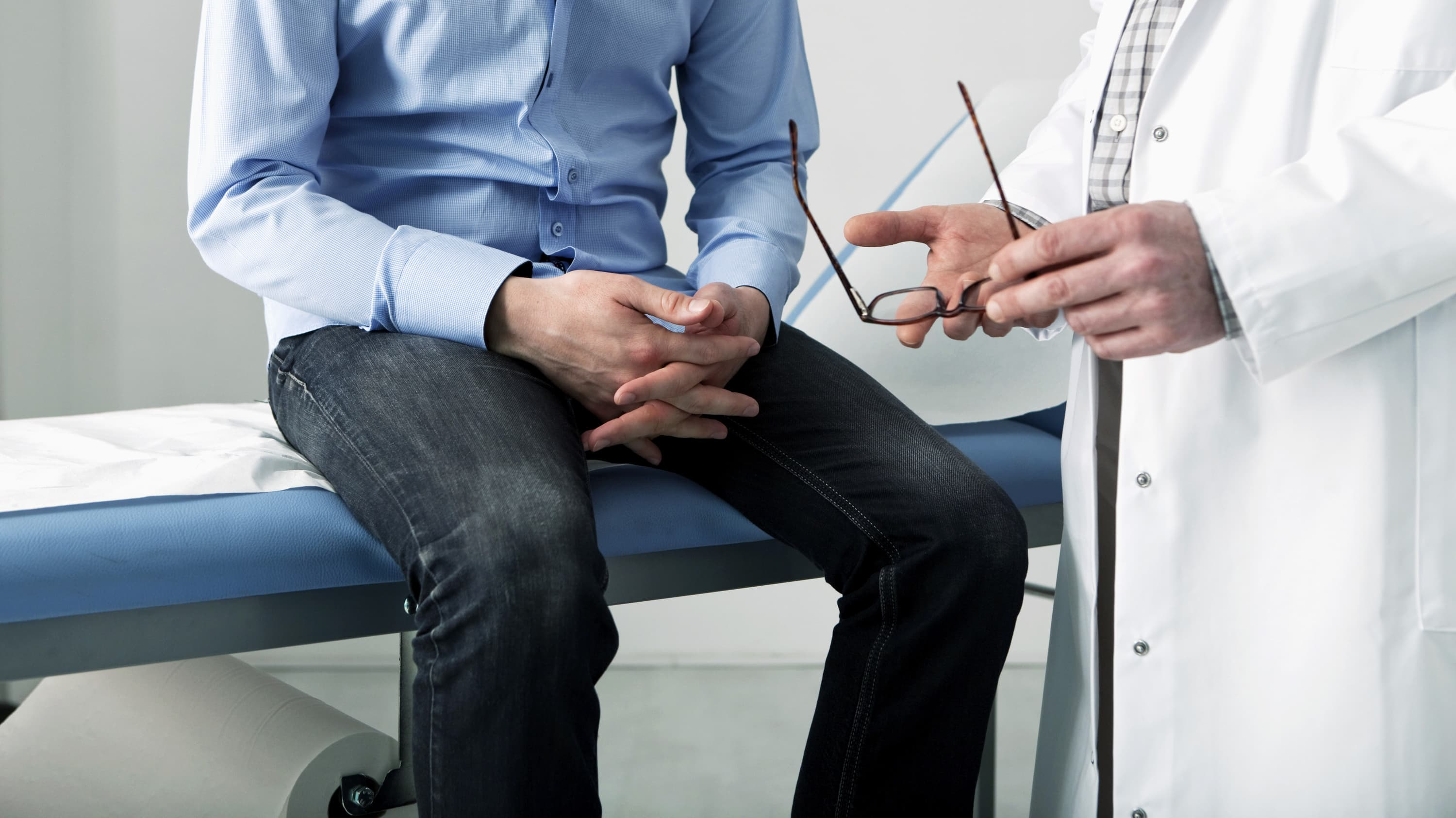 A man with epilepsy is having a conversation with his doctor.