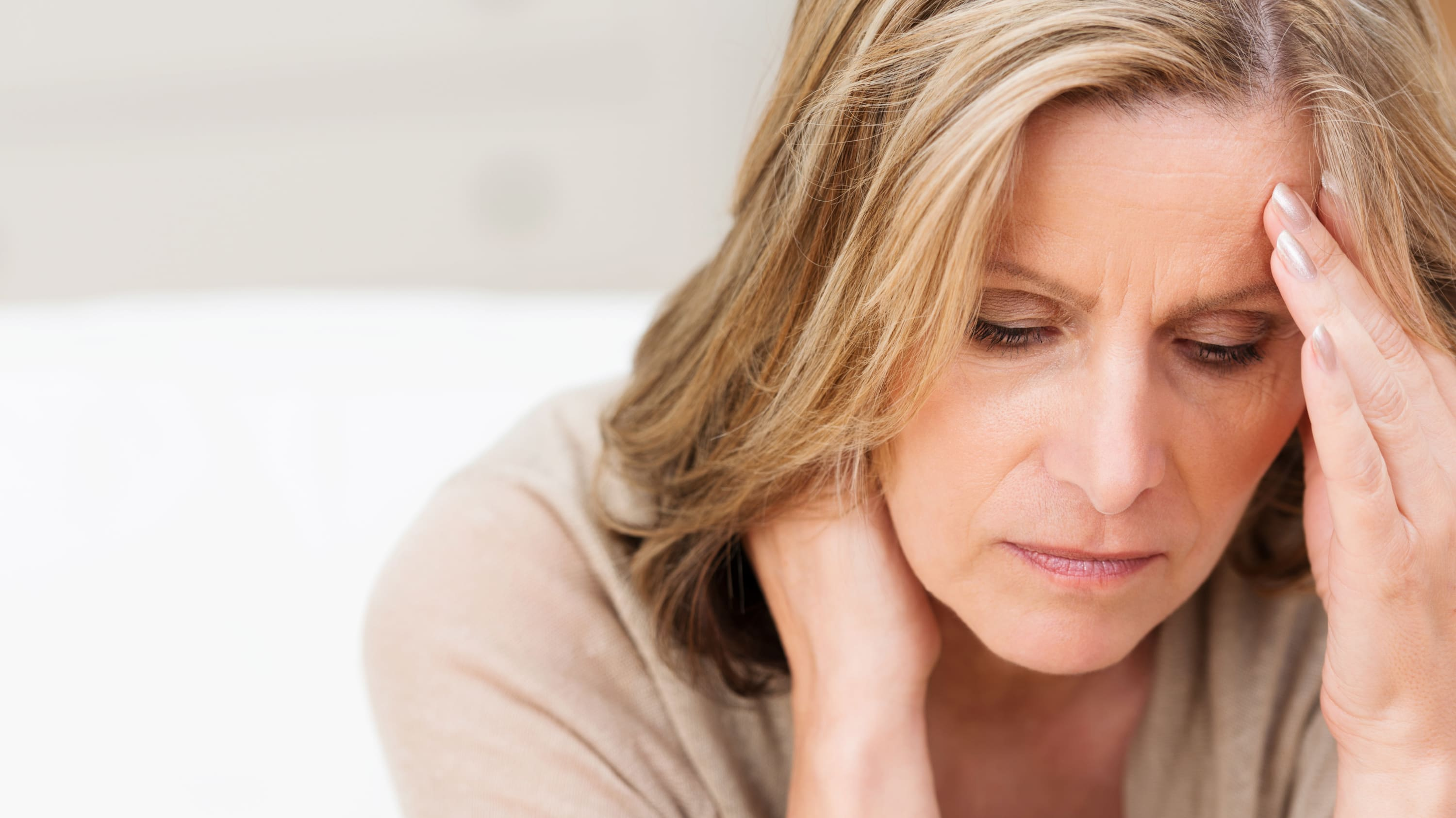 weary woman, possibly suffering from cancer-related fatigue