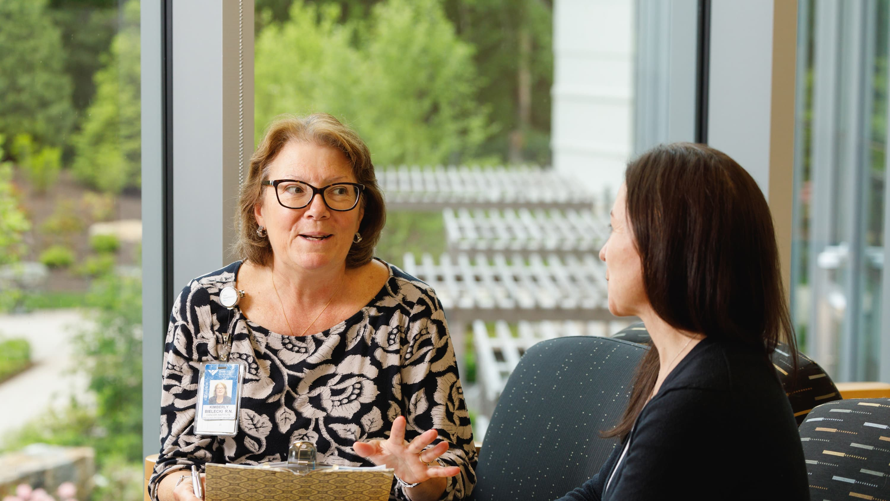A nurse talks to patient about her upcoming colonoscopy.