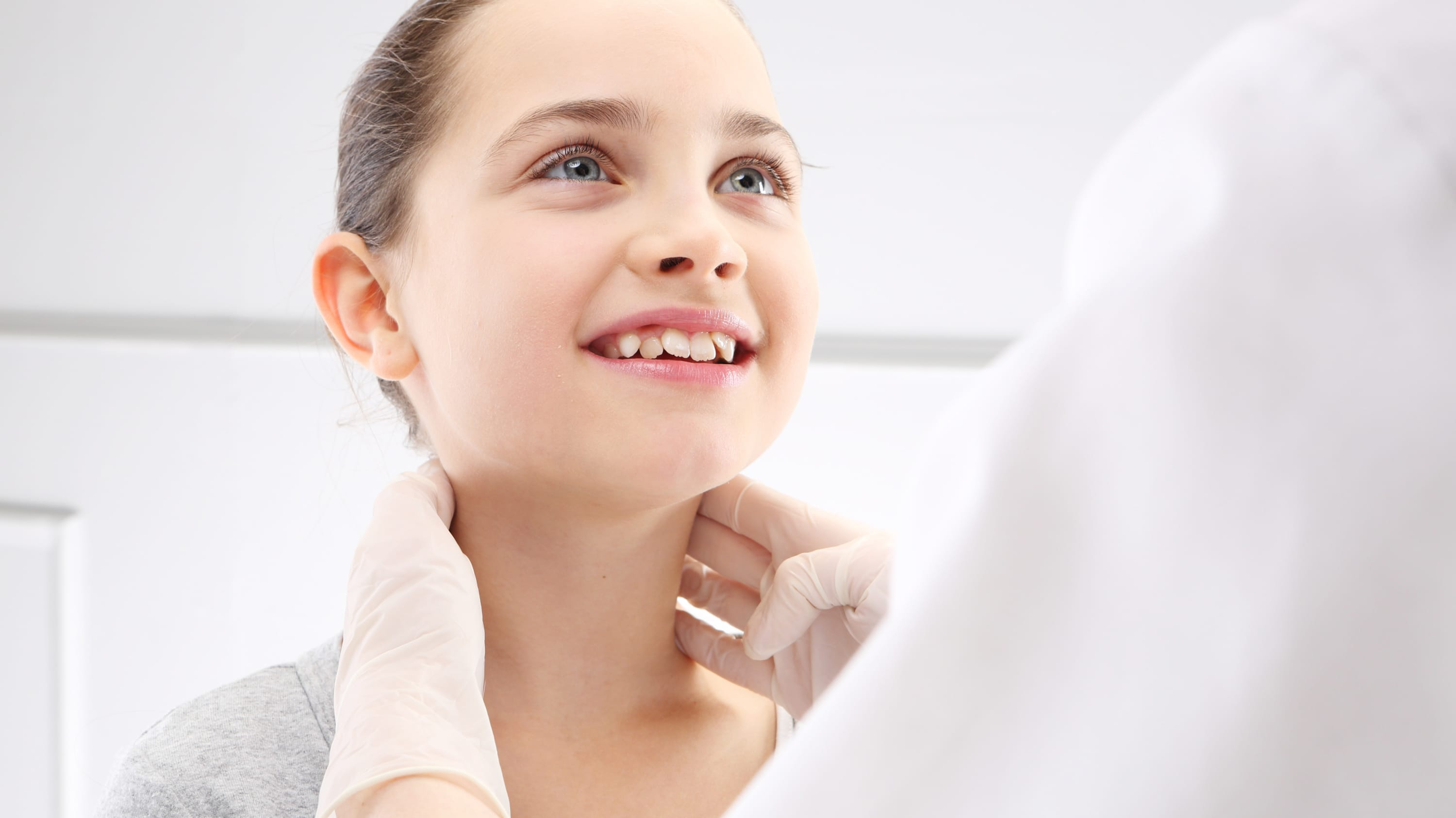 A young girl who might have strep throat is examined by her doctor