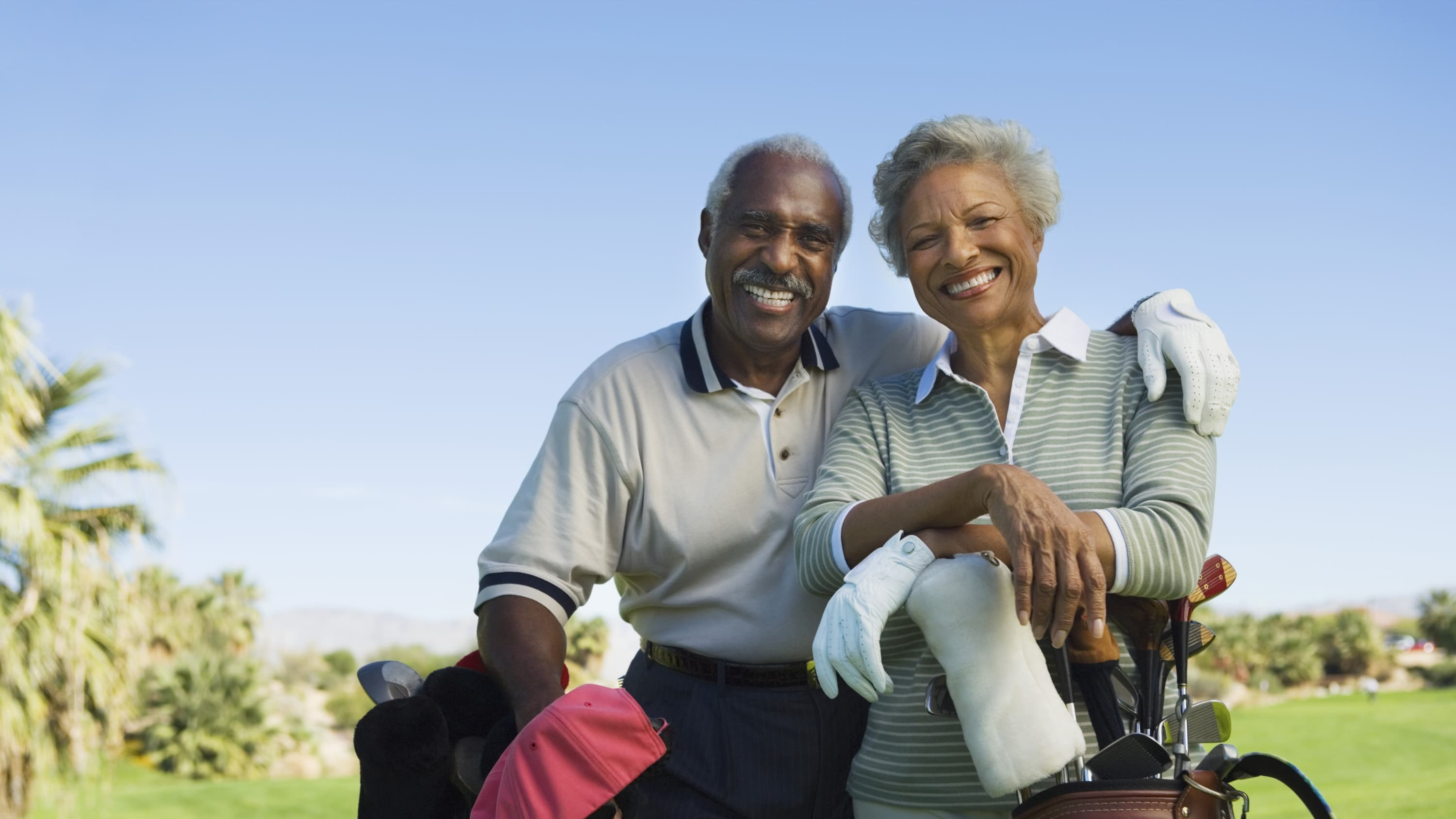 A couple playing golf, possibly after aortic aneurysm surgery