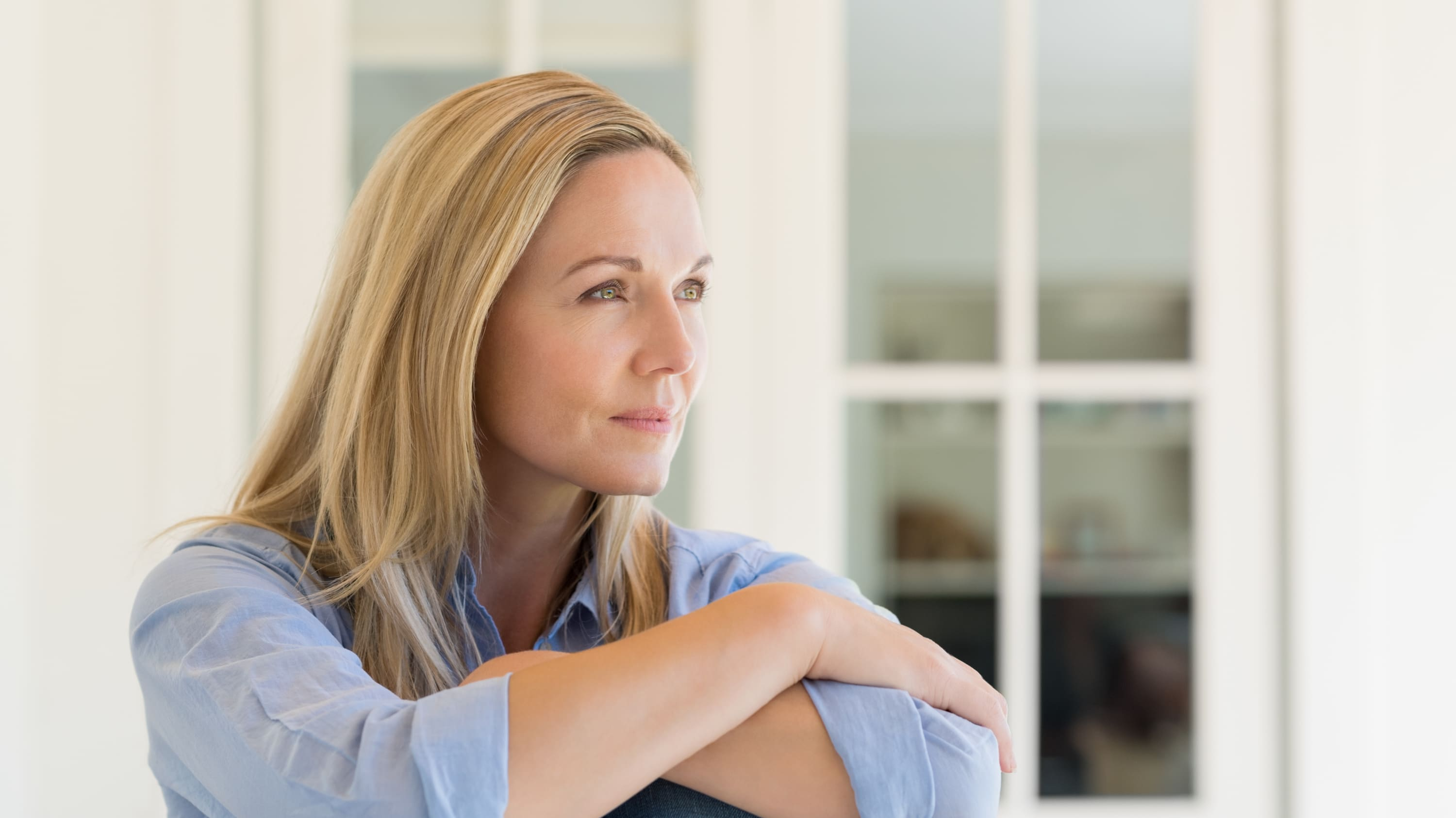 A woman is deep in thought, possibly thinking about neurogenic bladder