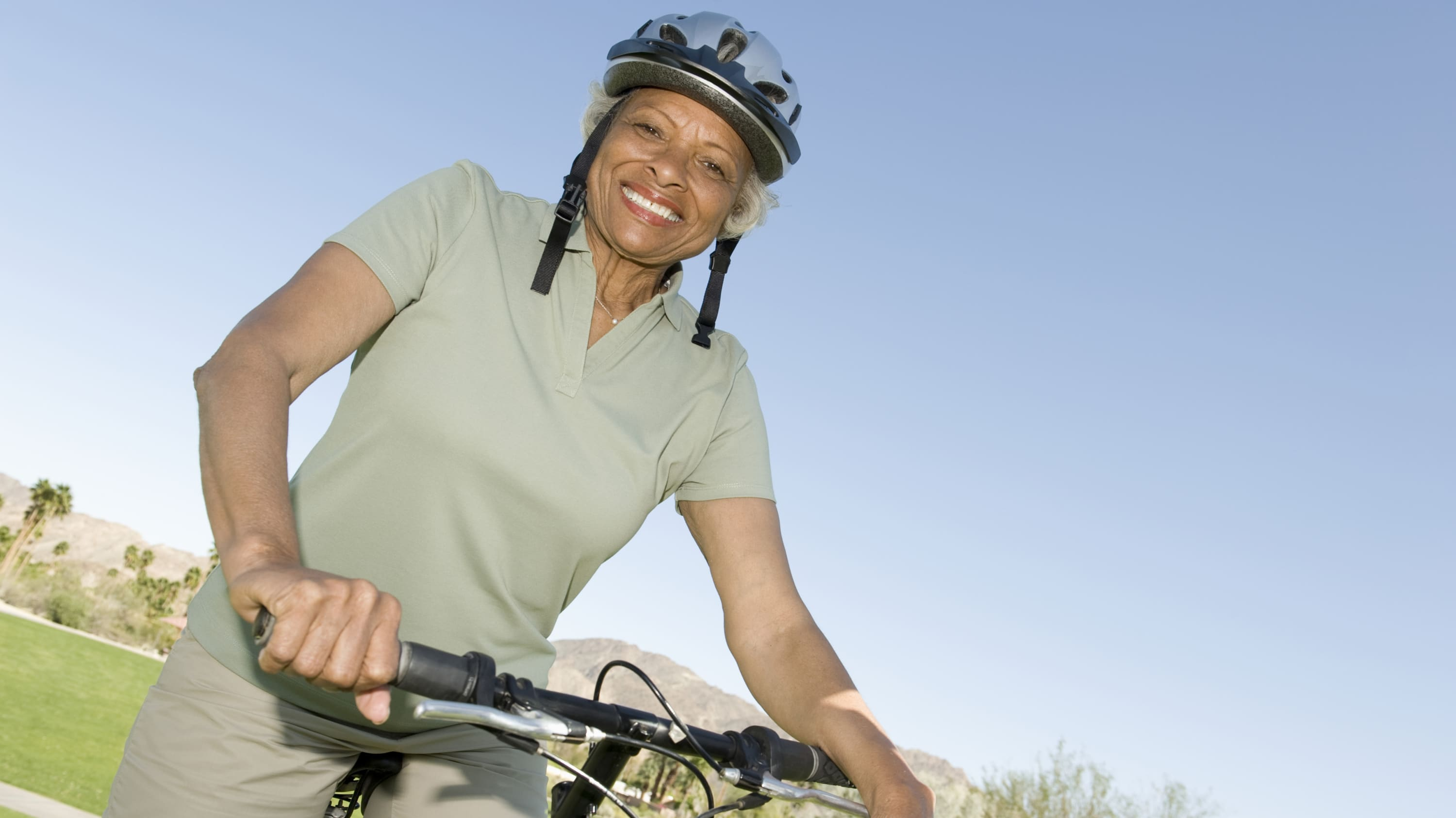 active, older woman smiling, possibly after receiving a total hip replacement