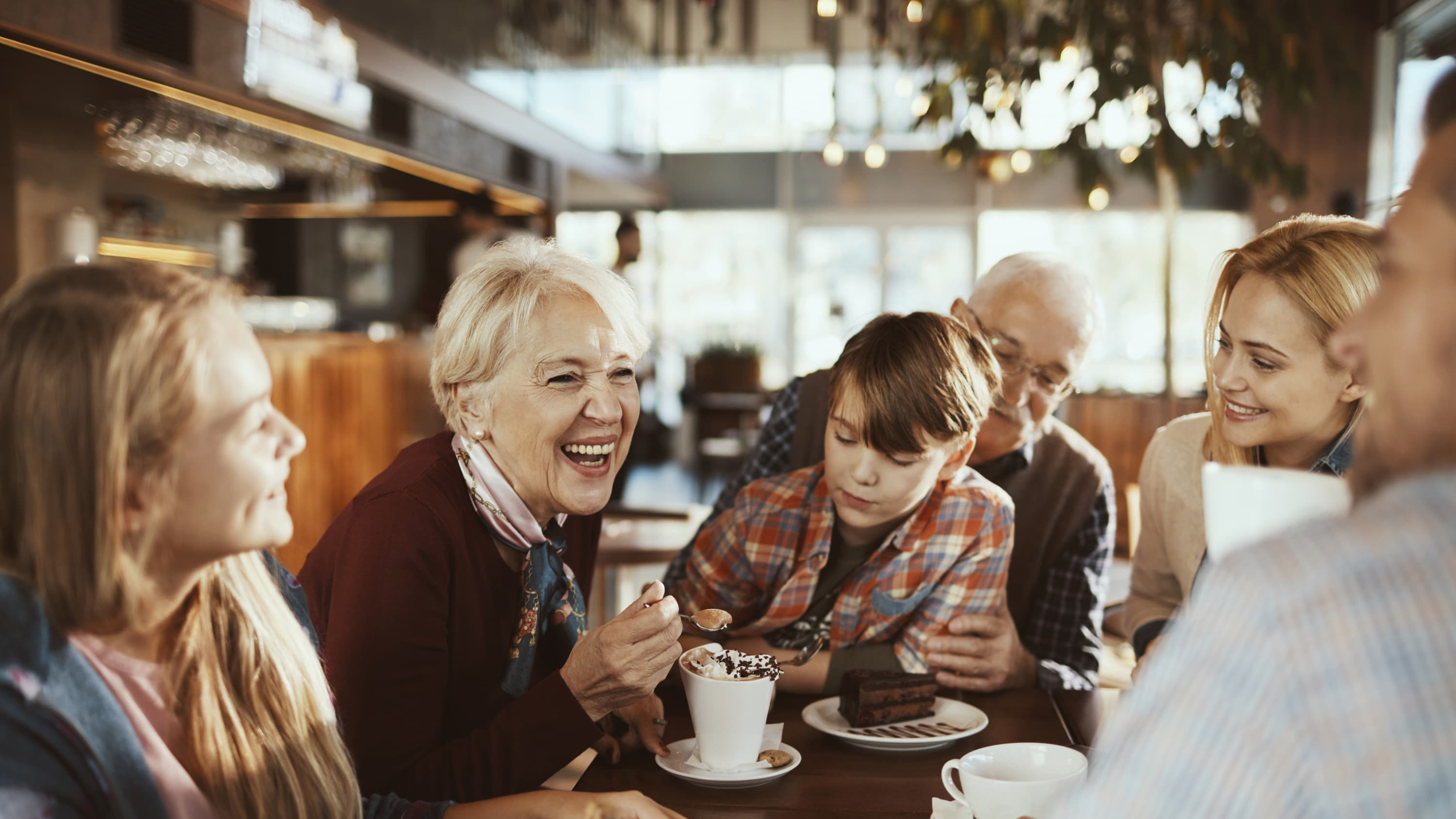 Multi Generational Family in a Cafe, highlighting the worry about COVID breakthrough infections