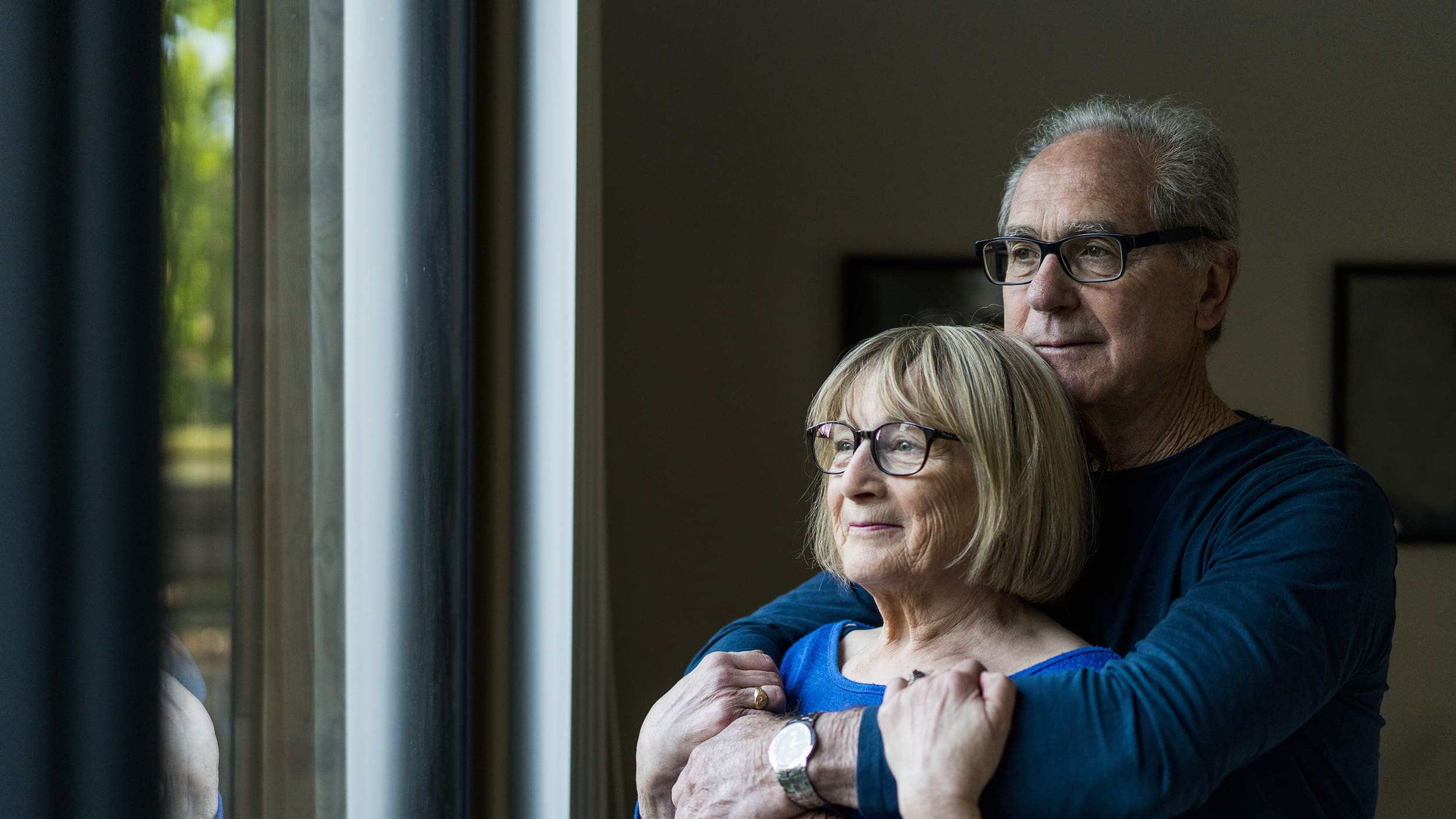 A couple comforts one another as one is about to undergo radiation therapy for liver cancer.