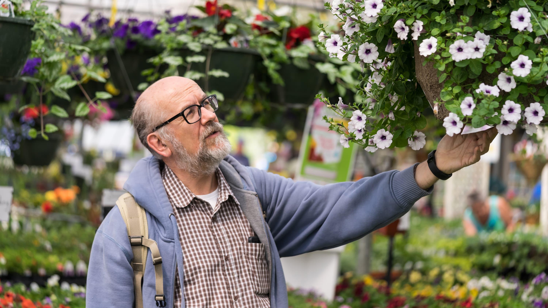 A man who may have had bladder cancer enjoys a garden walk.