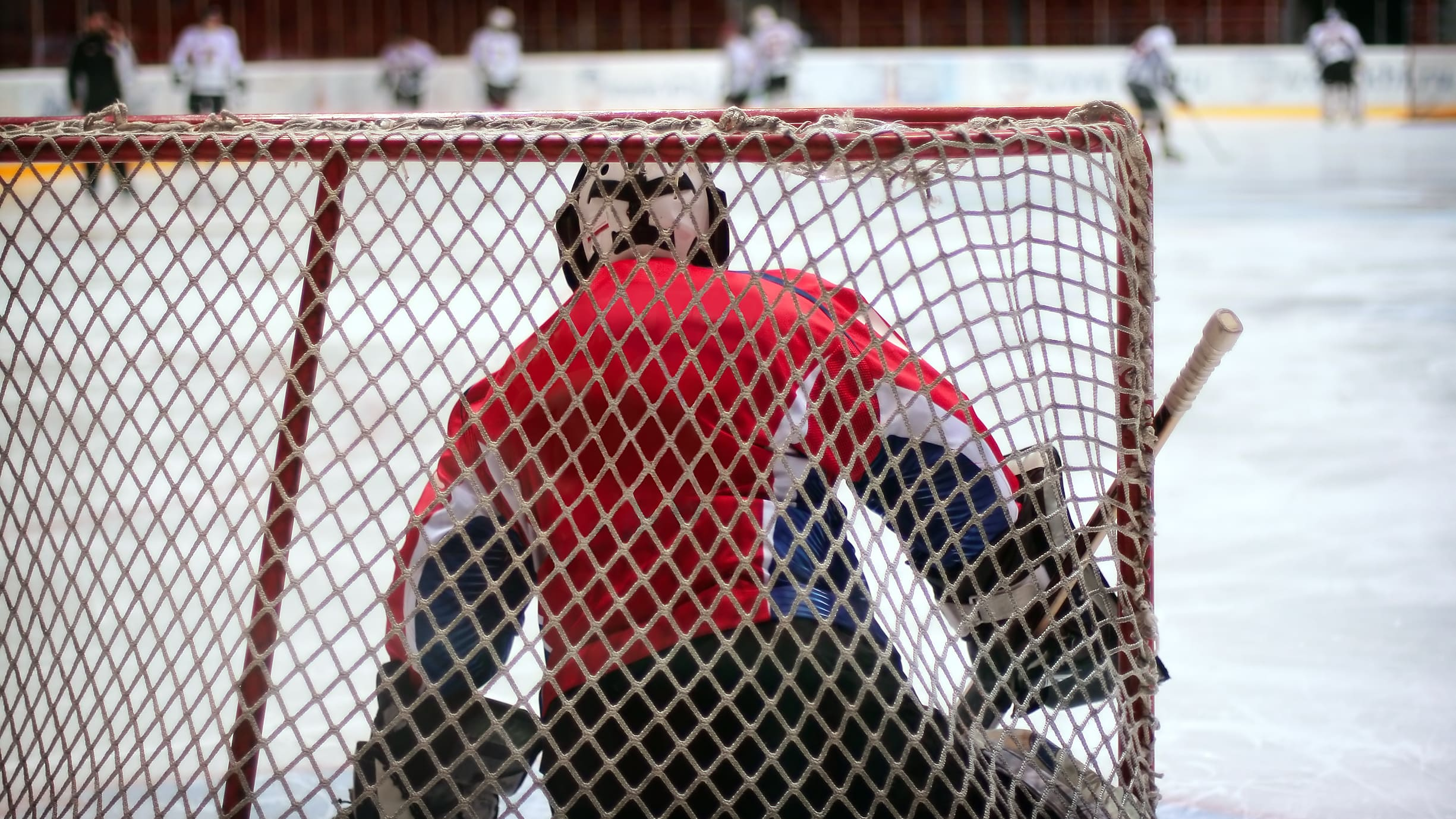 A goalie is at risk of suffering from a concussion during a game.