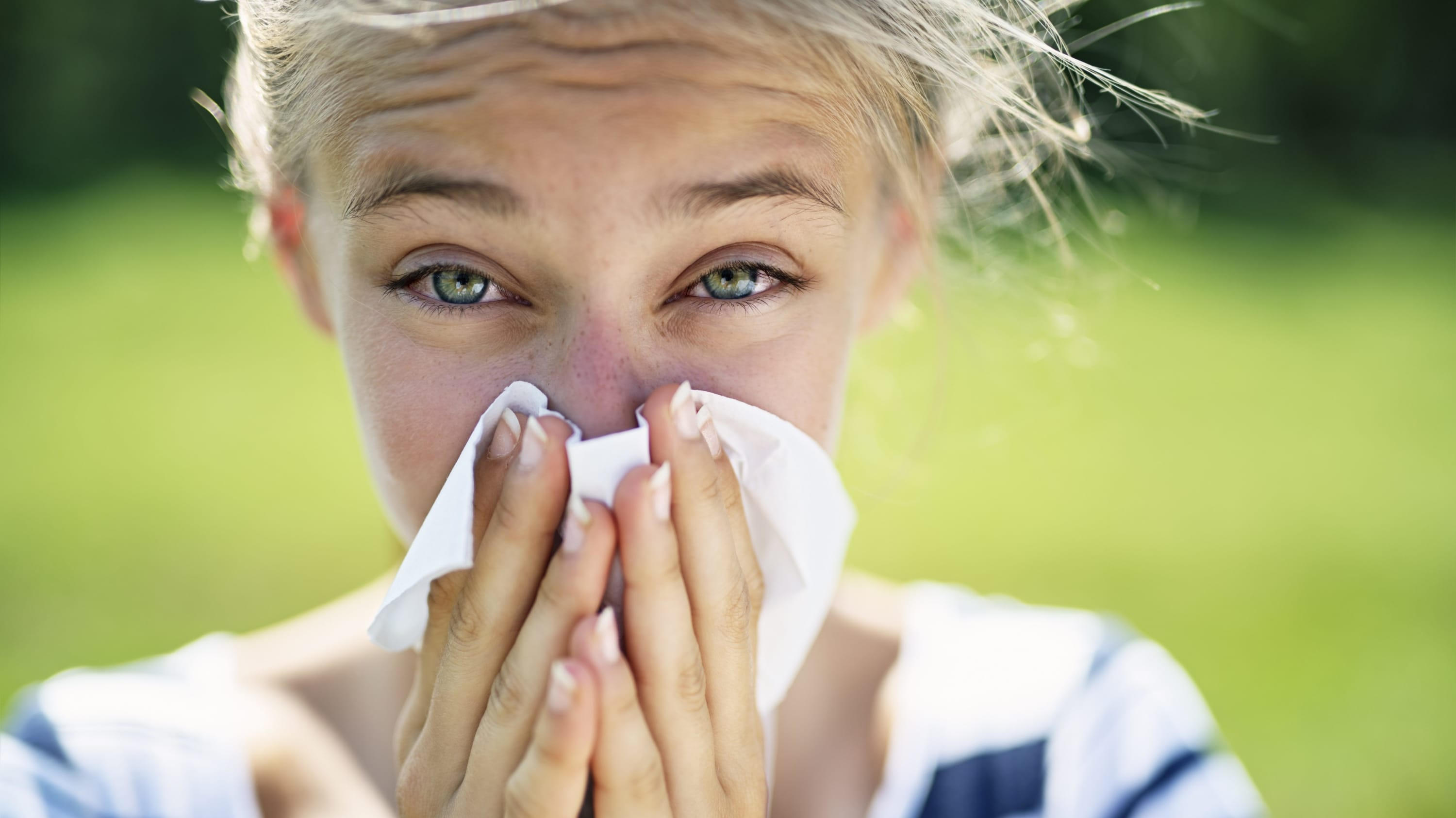 woman with nasal congestion from seasonal allergies
