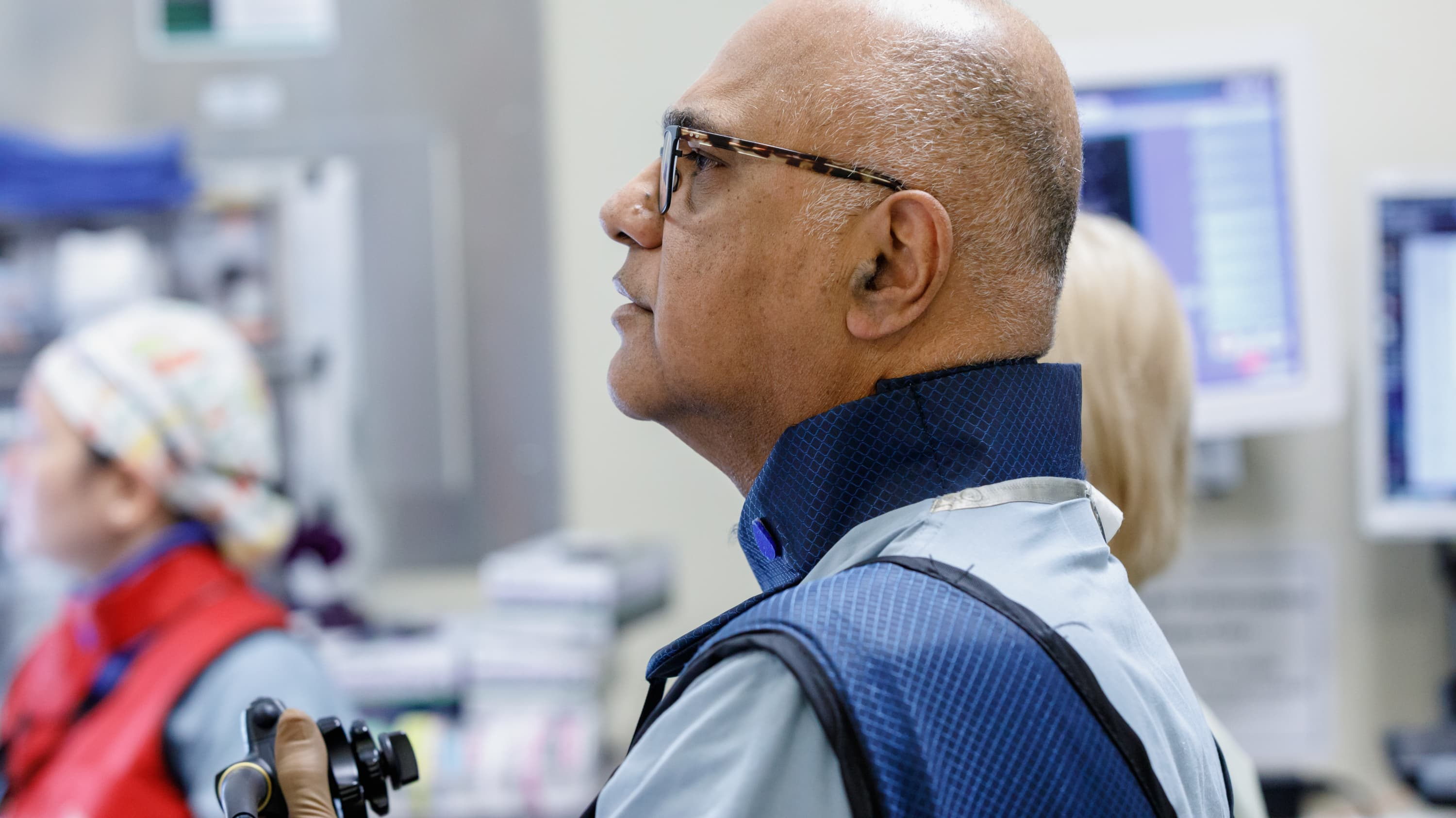 A doctor with glasses concentrates while conducting advanced diagnostic procedures for digestive diseases.