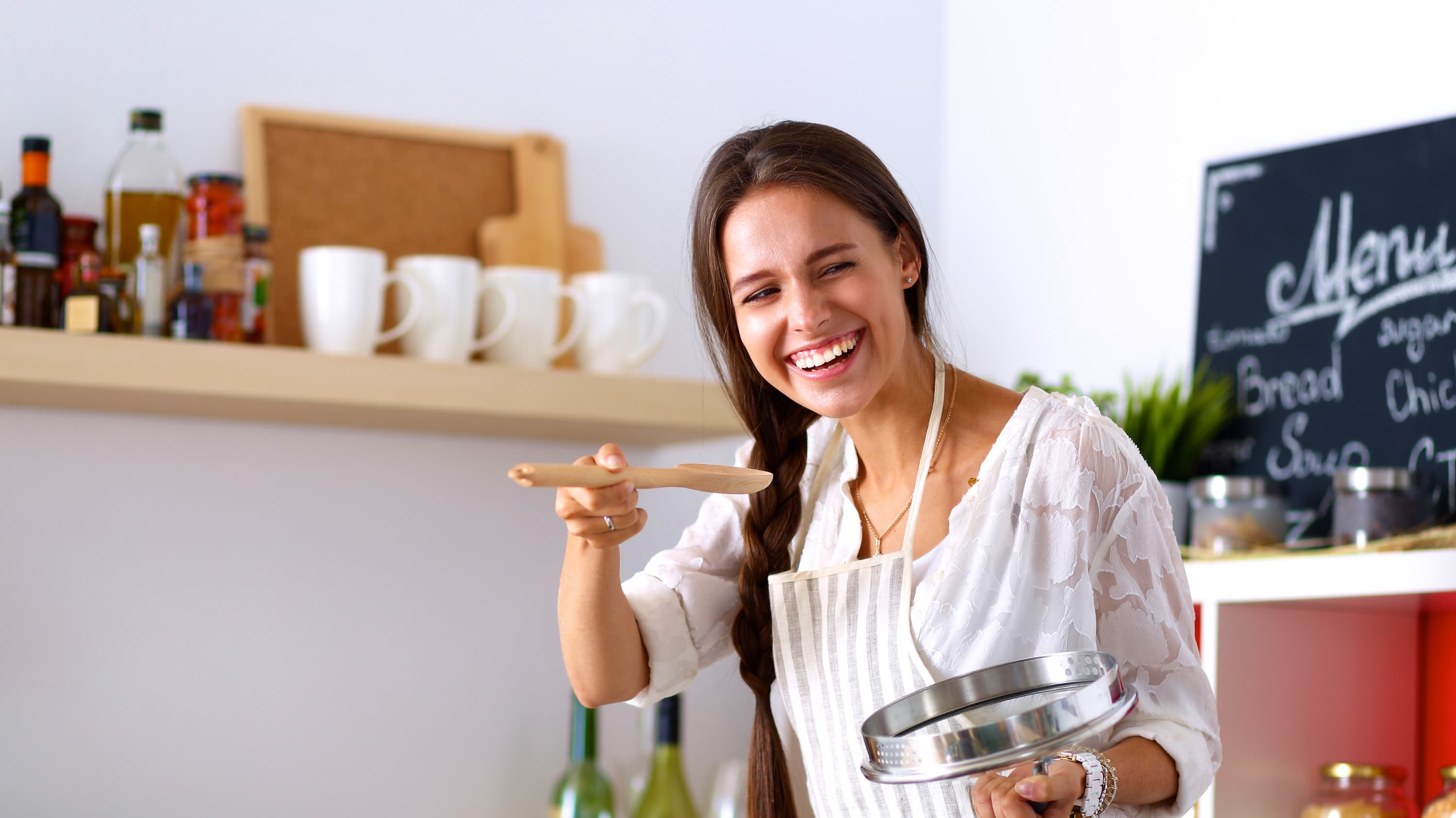 woman tasting and swallowing her cooking, which might be an issue for someone with esophageal cancer