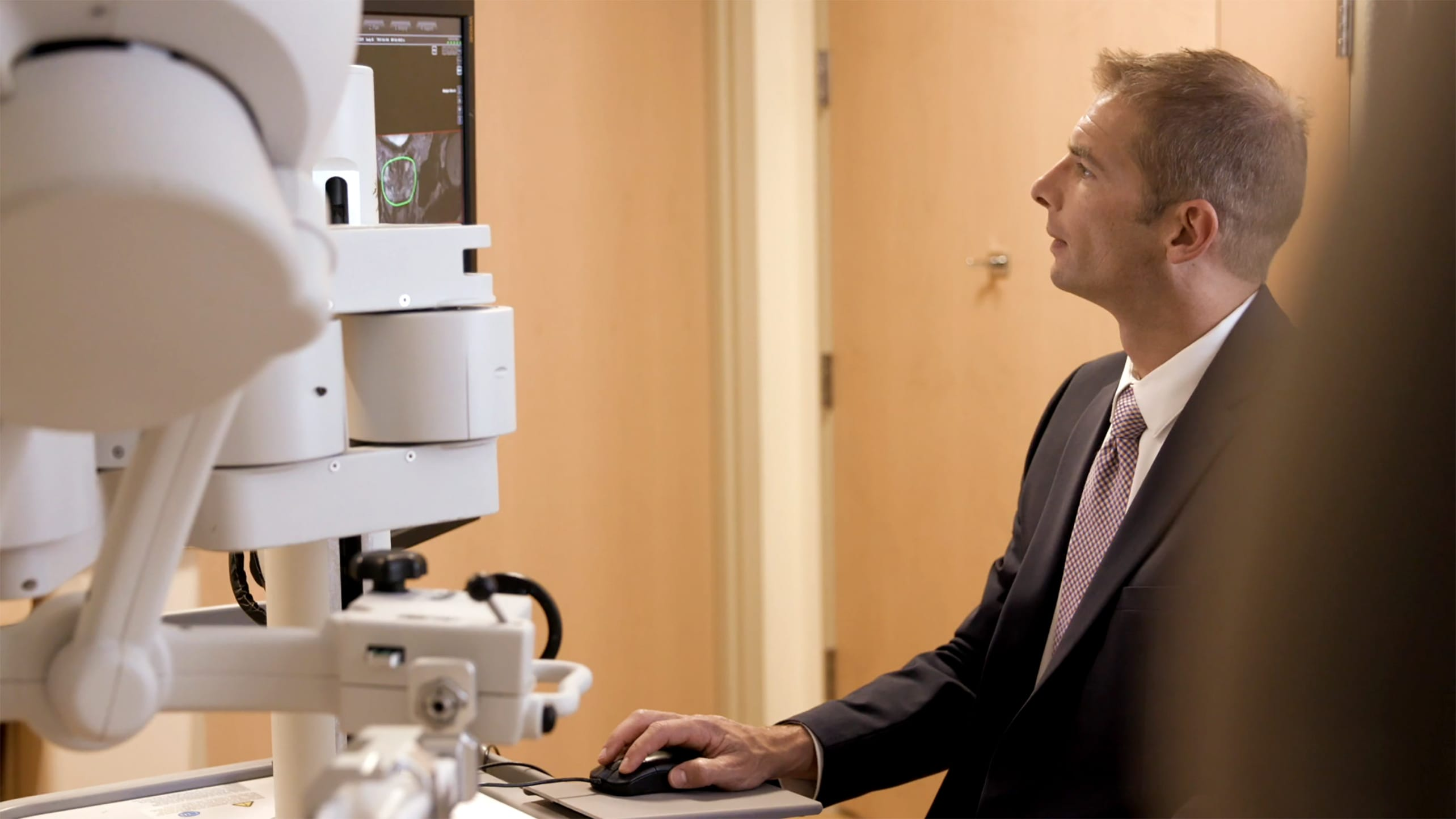 A doctor examines imaging to detect prostate cancer.