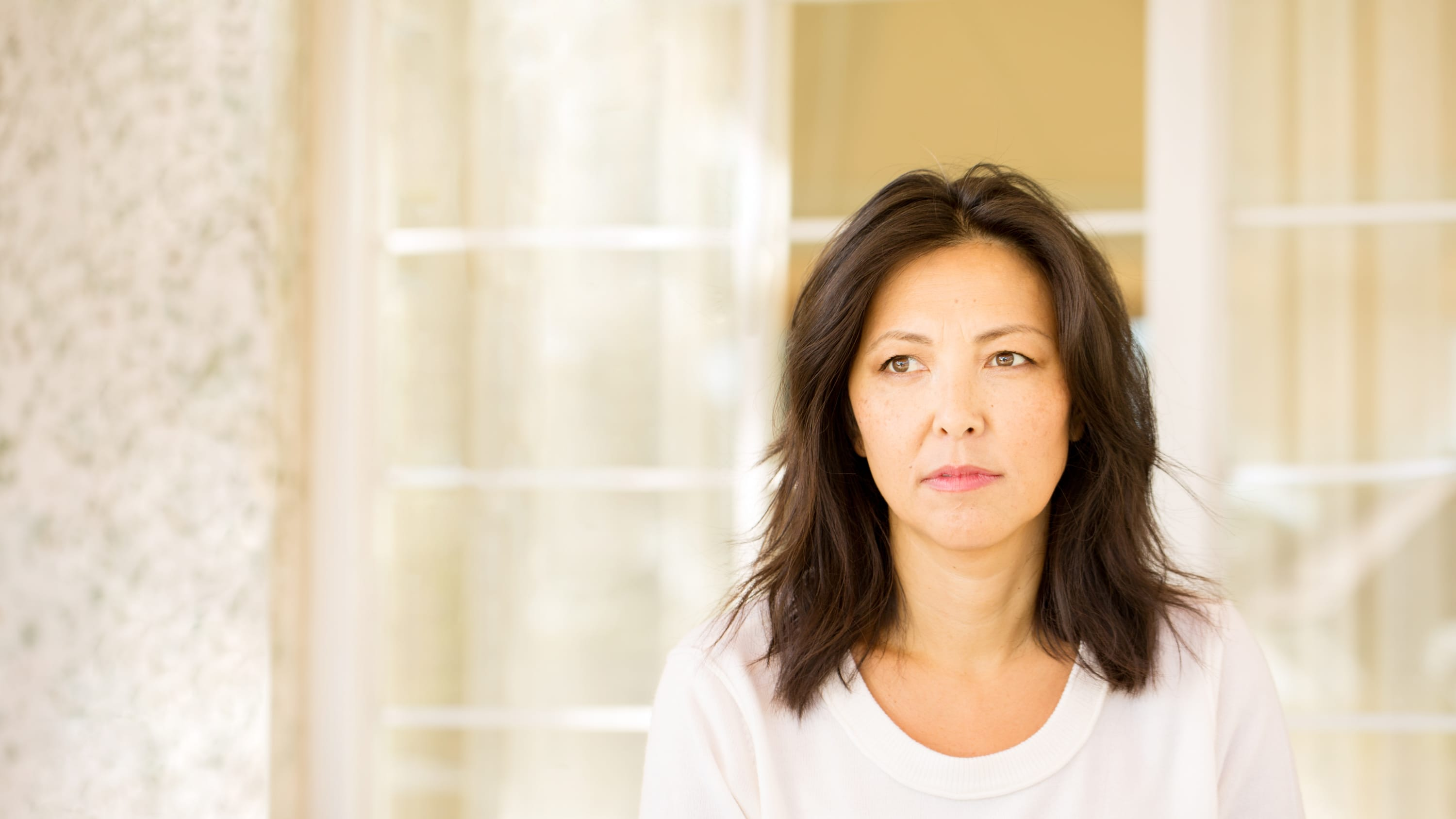 portrait of a woman looking pensive, possibly as a result of receiving a diagnosis of leukemia