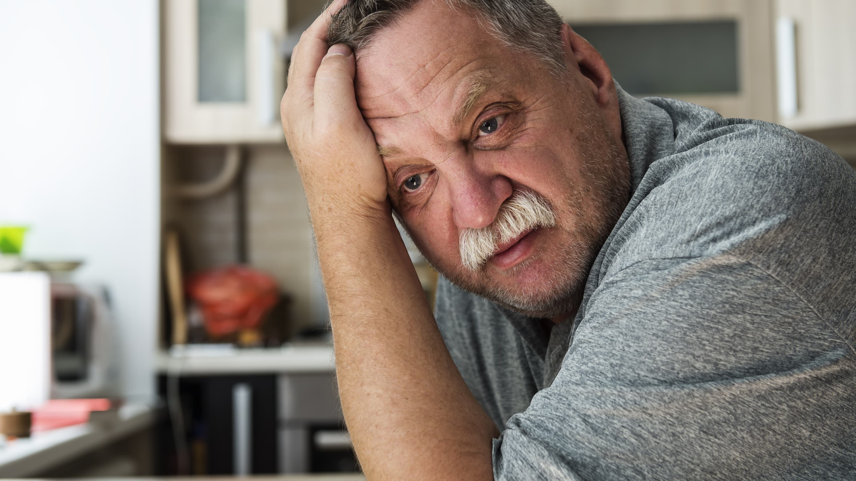 a man worried, possibly about urologic cancers