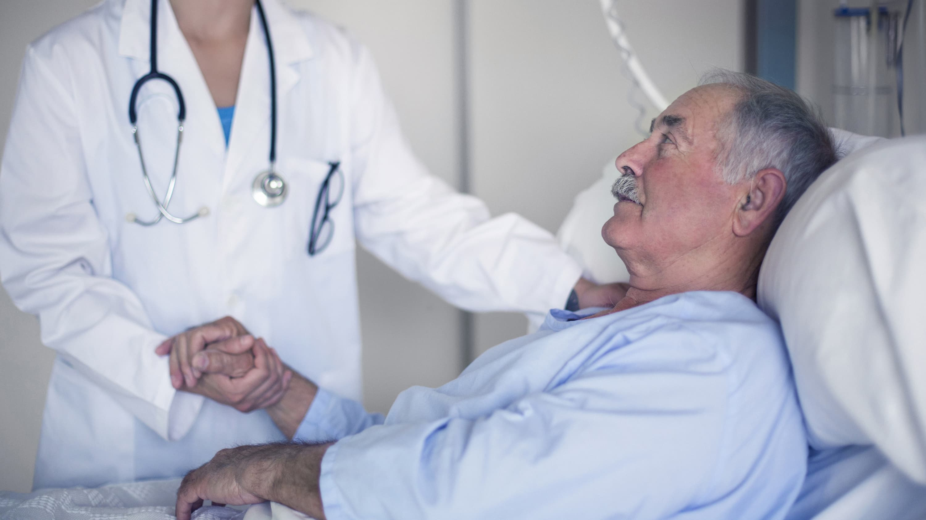A doctor consoles her patient with sepsis.