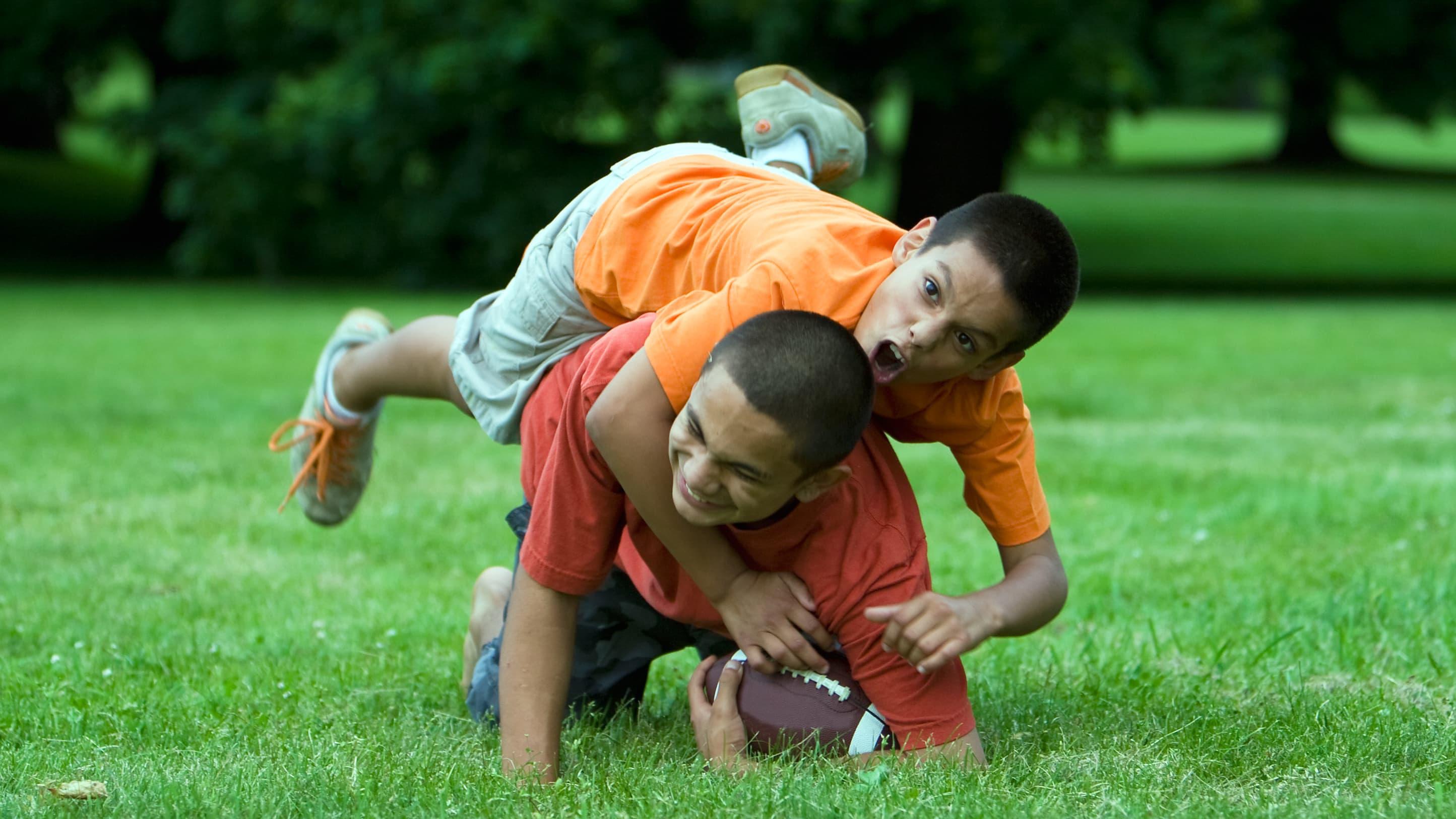 two kids playing football