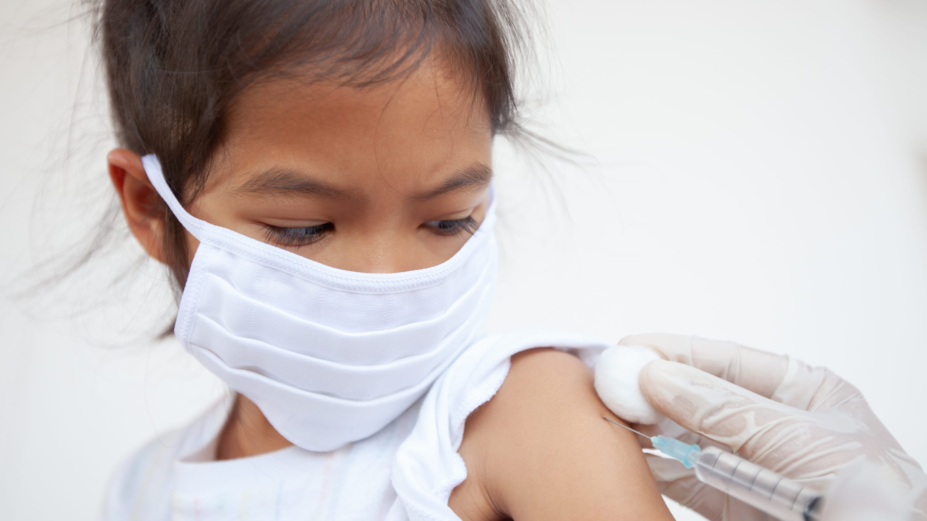 girl receiving a vaccine, potentially for COVID-19