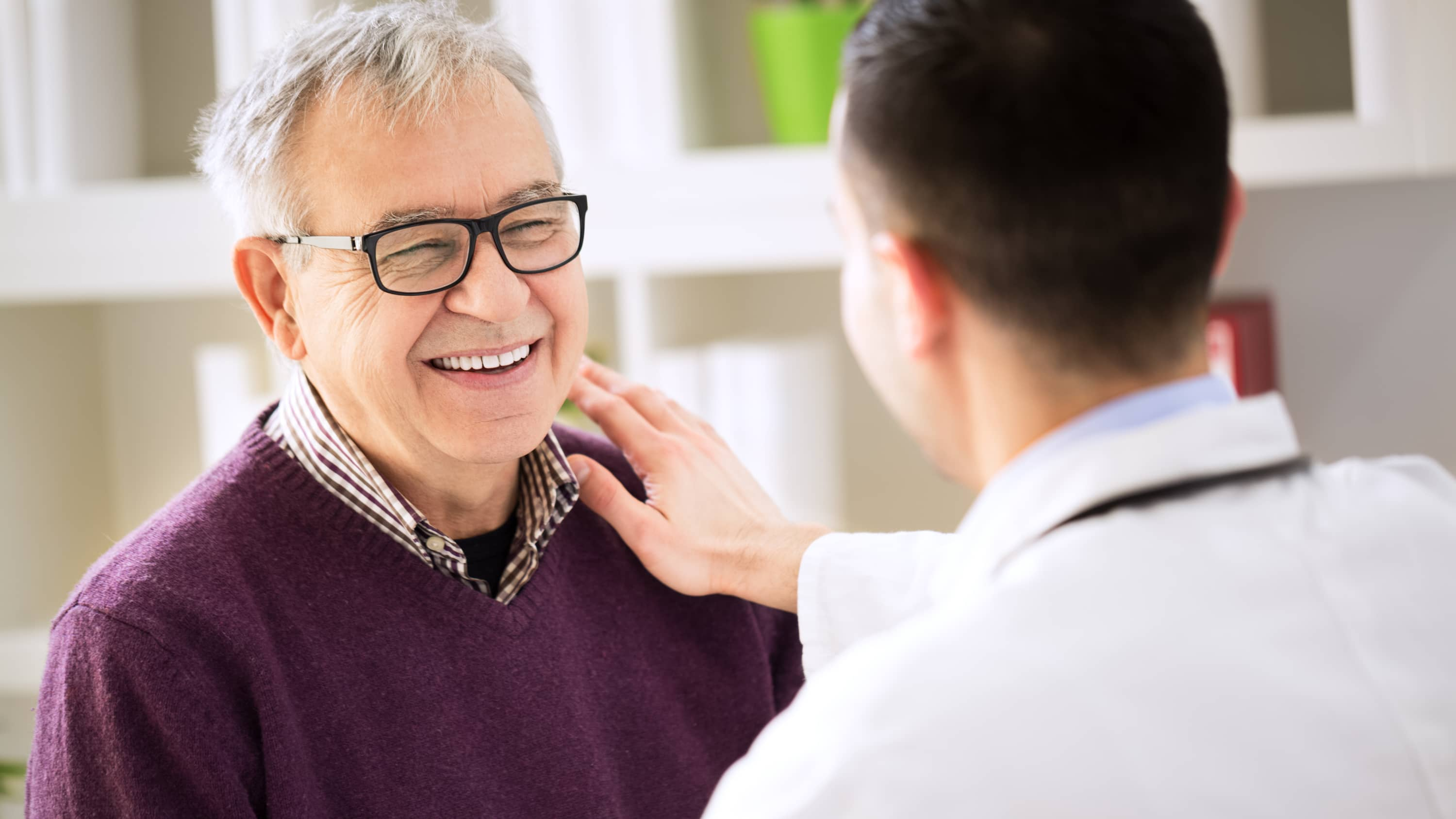 A patient possibly discussing prostate artery embolisation with his doctor.